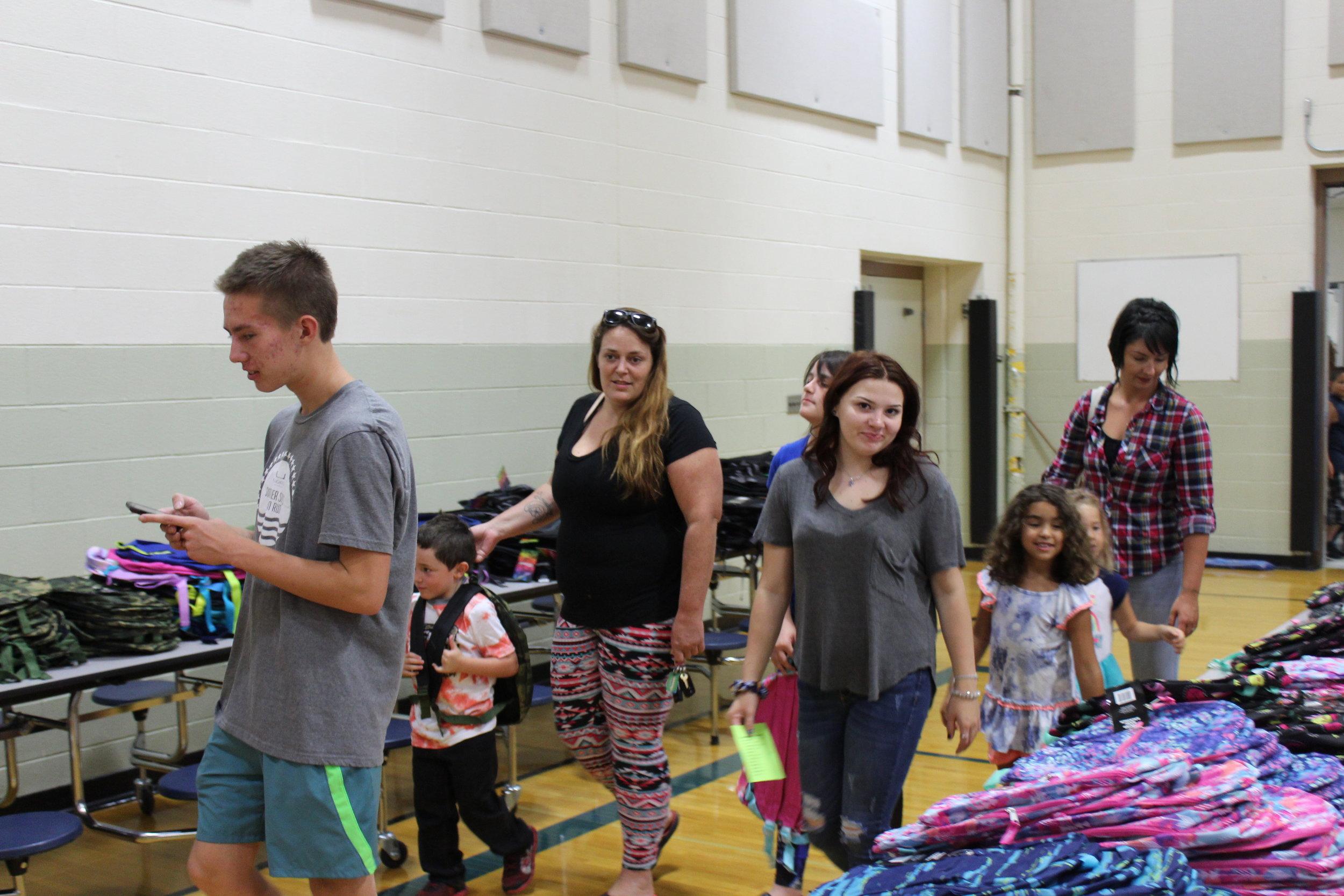 Carter Hosking and Elisabeth Plant help EV family.JPG