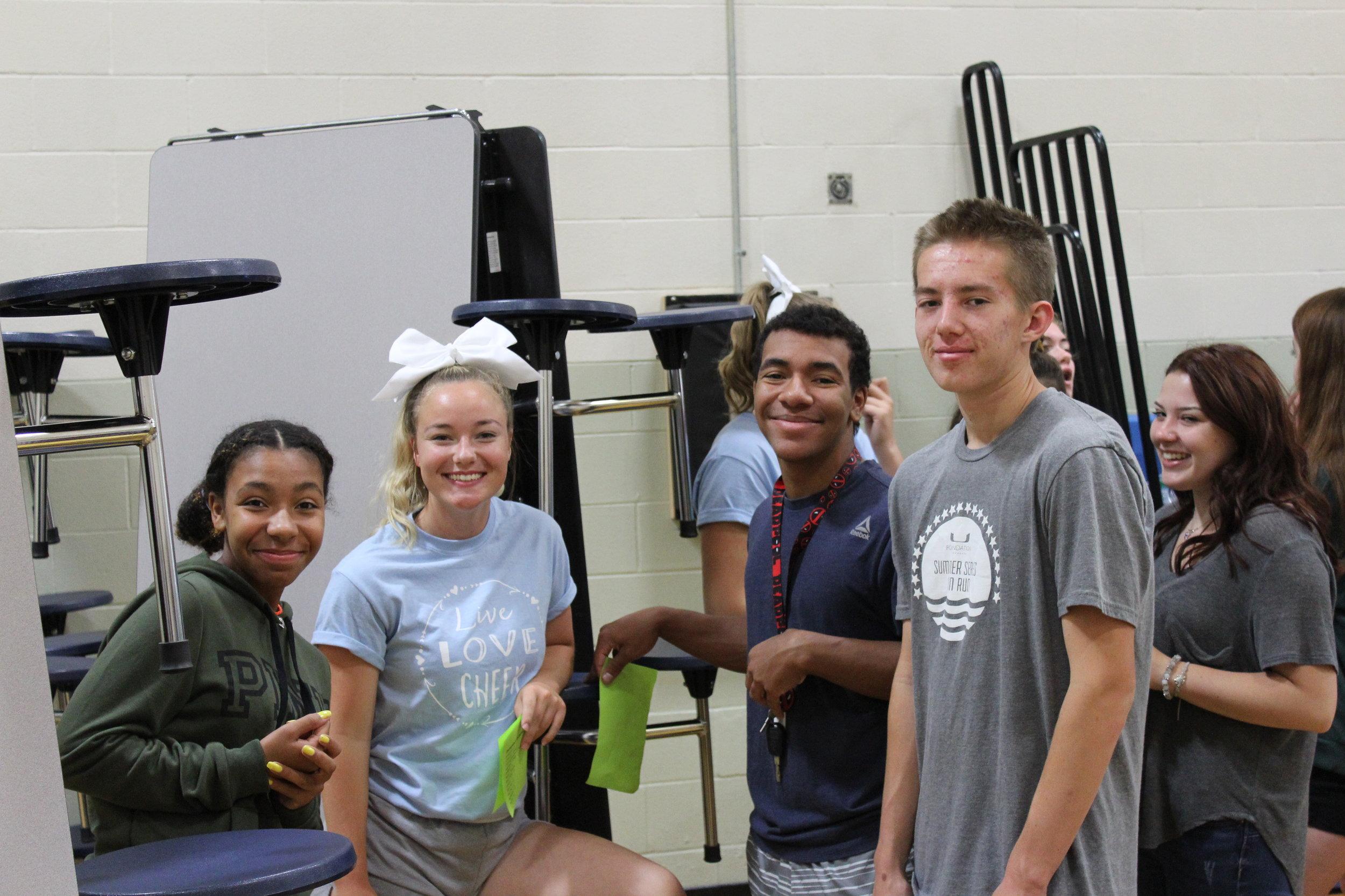 FBLA members_ Jasmine McGee, Dani Hillyard, RJ McGee, and Carter Hosking help with Back to School Fair.JPG