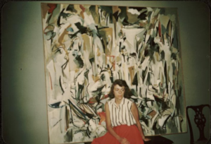 Joan Mitchell with her painting Untitled (1951) in her parents' apartment in Chicago, Michael Goldberg papers, 1942-1981, Archives of American Art, Resource URI: http://data.aaa.si.edu/object/8696