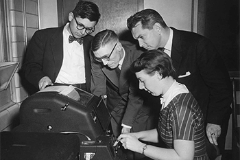 Audrey Bates, operating the world's first remote computation session in 1955. (c)  University of Toronto Archives . Bates was Toronto's expert on the Ferranti Mark I and her name is often found on the internet in association with this photograph, although sometimes incorrectly described as a 'Canadian National telegraph operator'.
