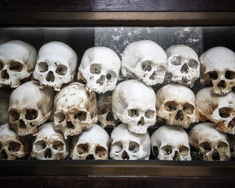 The memorial pagoda with 9,000 skulls of the victims killed at Choeung Ek
