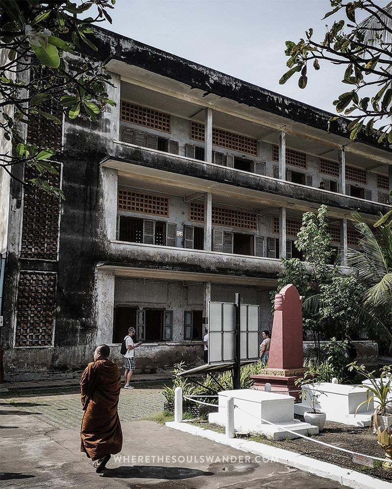 A monk walking through the s21 prison
