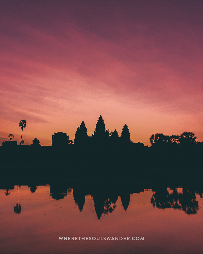 Experiencing this impressive sunrise at Angkor Wat in Cambodia