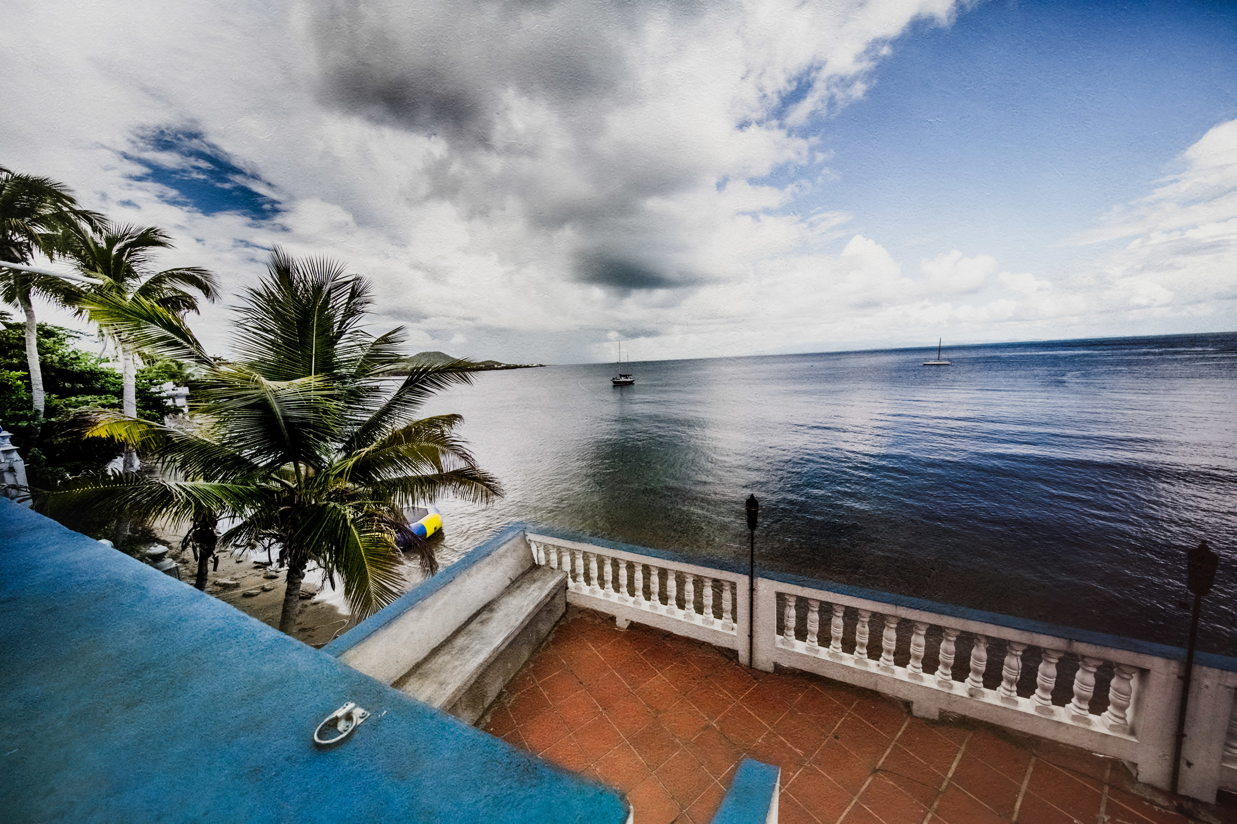THE LOCATION IS STEPS FROM VIEQUES HARBOR, THE PERFECT SETTING FOR SUNSETS, LIBATIONS, AND CONVERSATION. -