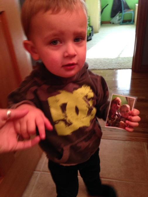 Harvey at 26 months old, non-verbal, bringing me our picture. He smooched the picture and in turn I picked him up and covered him in smooches