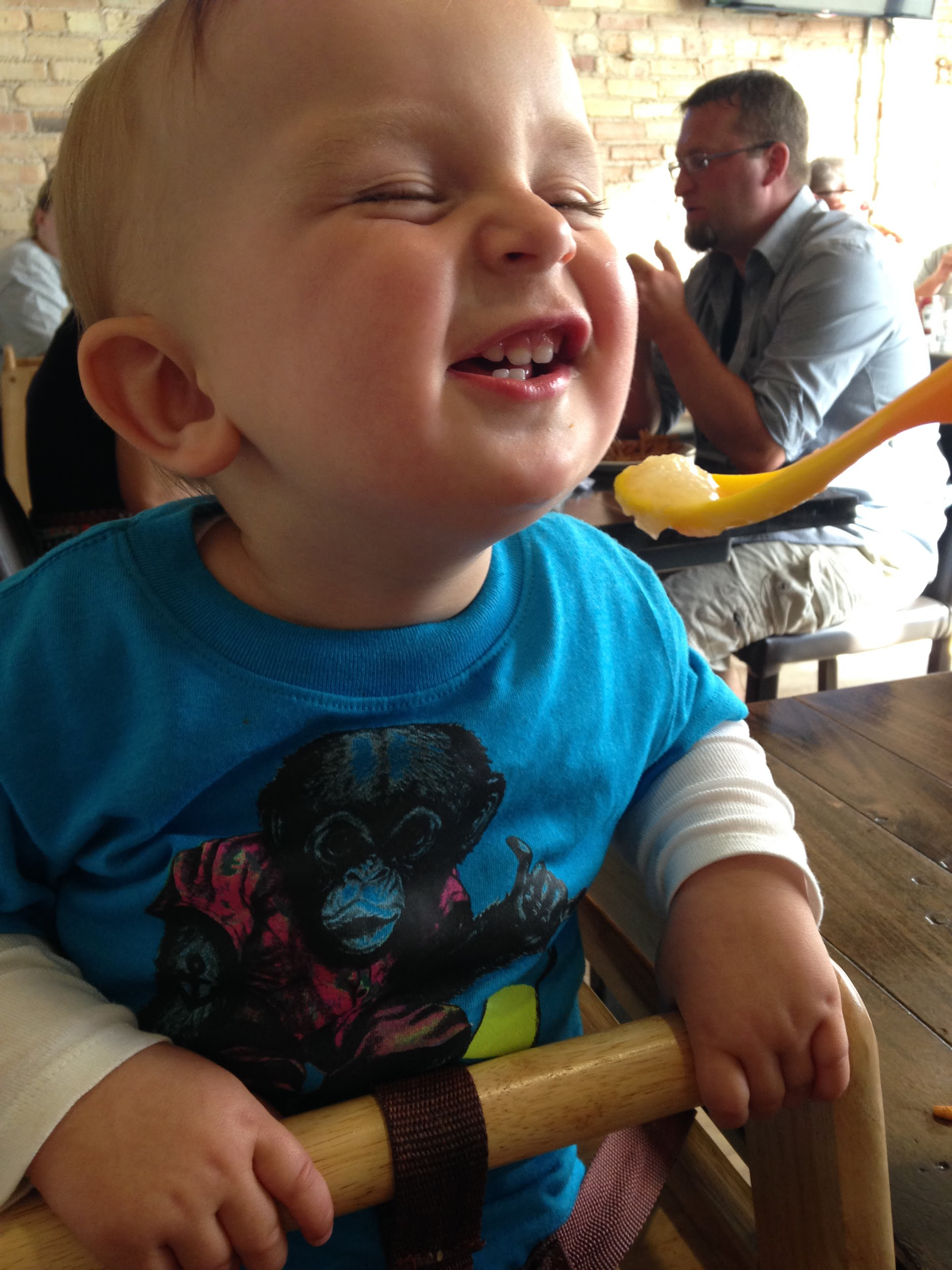 Harvey enjoying some applesauce at when he was 1.5 years old and pictures of the kids' plates