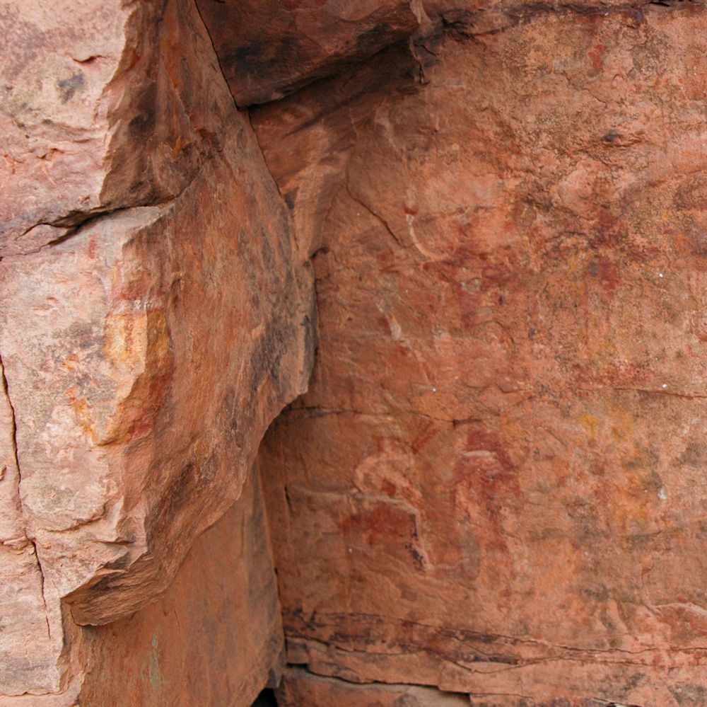Dancing Star Man (Middle-right), White Man (upper-middle), Mask on Corner of Rock (middle-left)