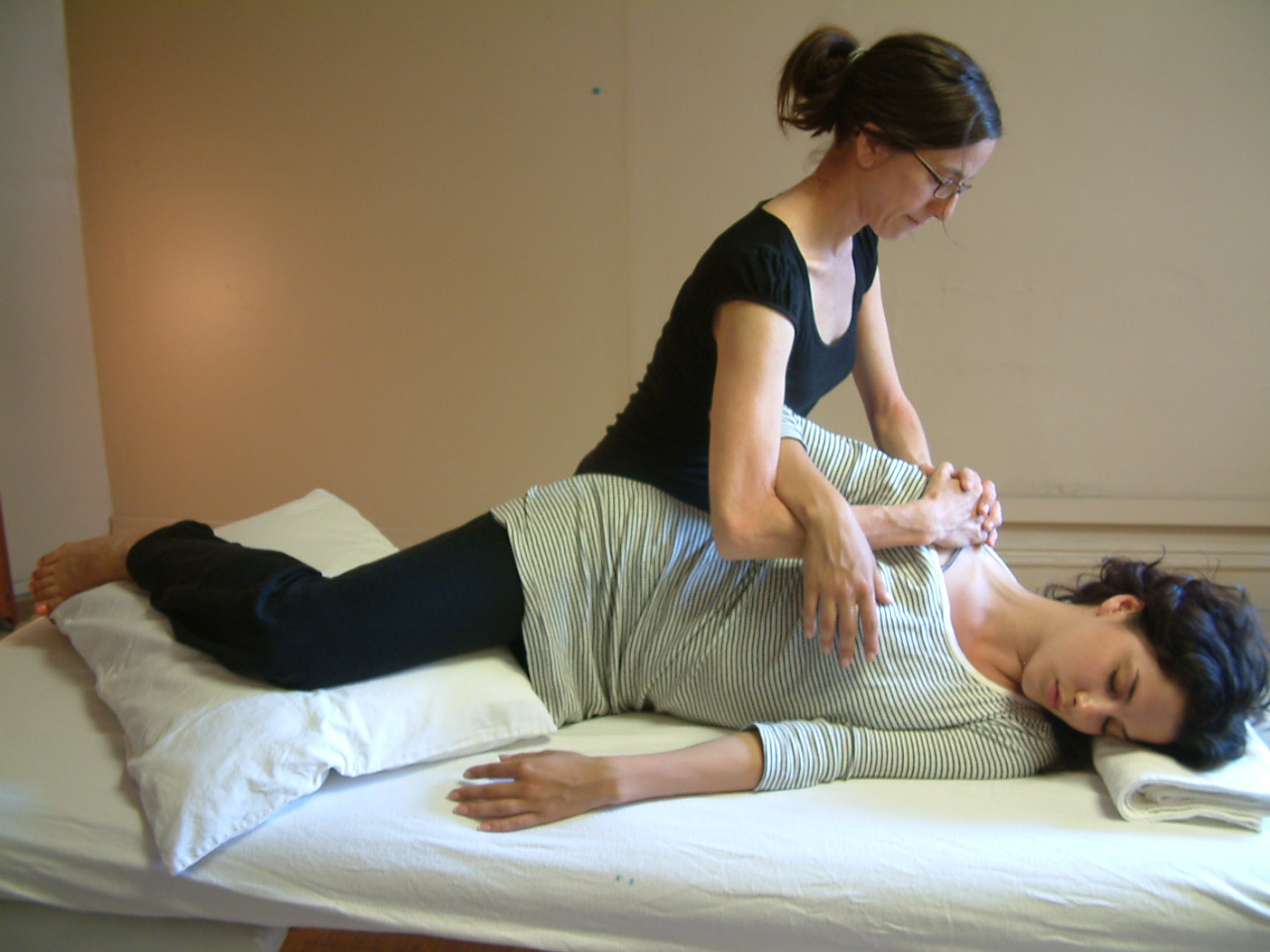 Benefits - Shiatsu is an incredibly effective way to treat pain and ease emotional stress. The long-holding pressure used during a shiatsu treatment activates the parasympathetic nervous system. This gives your body a break from the state of high alertness and intensity many of us need to maintain in order to get through our busy days. Your body's attention shifts to the internal organs: your peripheral muscles and nerves relax, digestive organs become more active, secretions increase, blood pressure and heart rate decline, your busy mind quiets and in general, your body prepares to relax and heal. On top of all of this, the pain and stress you came in with will be greatly reduced.Conditions Shiatsu Helps: Back Pain, Neck and Shoulder Pain, Anxiety, Depression and Fatigue, Stress, Carpal Tunnel Syndrome, Repetitive Strain Injury, Arthritis, Bursitis, Joint Pain and Fibromyalgia, Sciatica, Spinal Stenosis, Sports Injuries, Pregnancy-related issues, Insomnia.