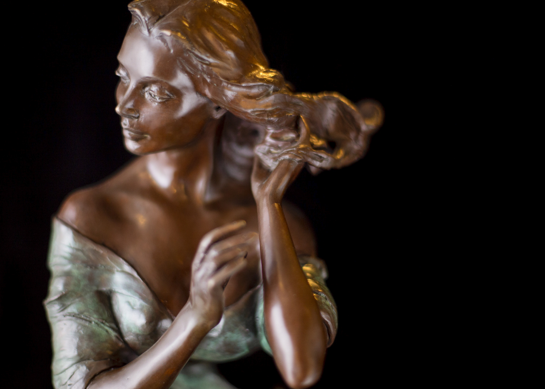 "April | 21"" x 10"" x 10"" | Bronze | $2,800"