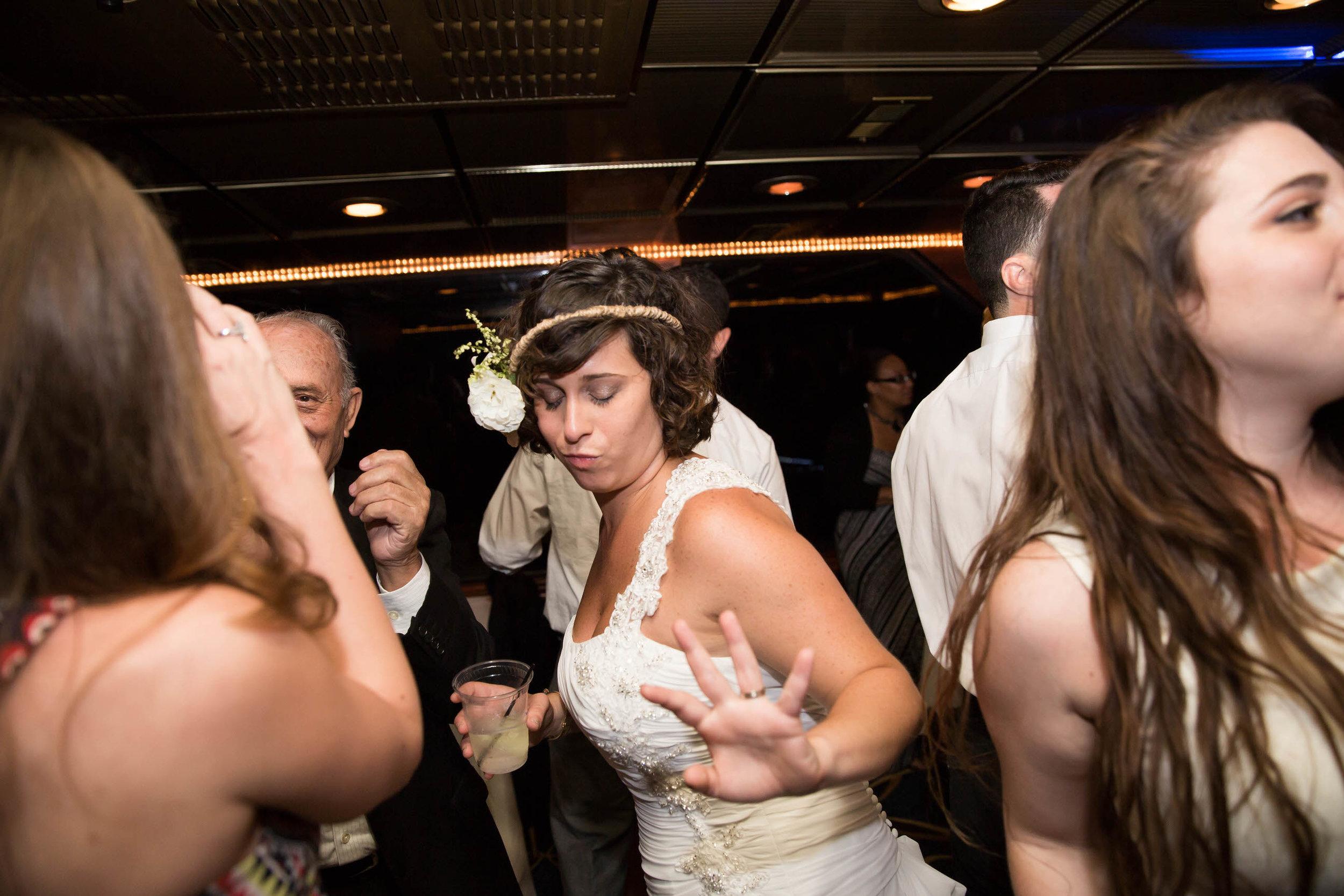 bride-dancing-boat-wedding-destination-photographer-tiny-house-photo.jpg