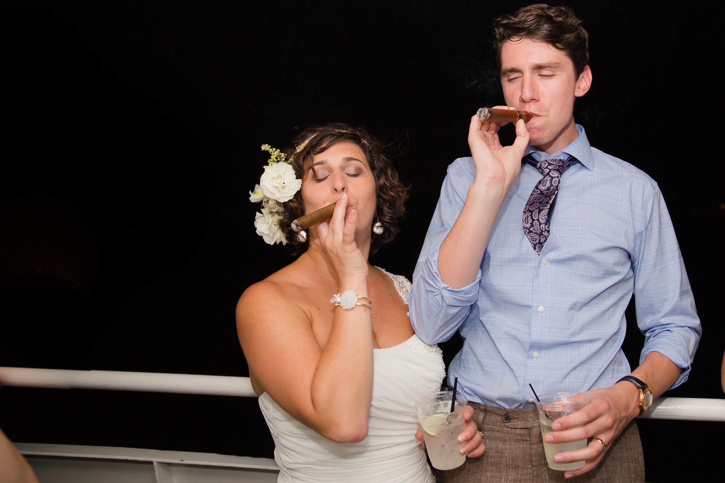 bride-groom-cigars-tiny-house-photo-boat-destination-wedding-florida.jpg