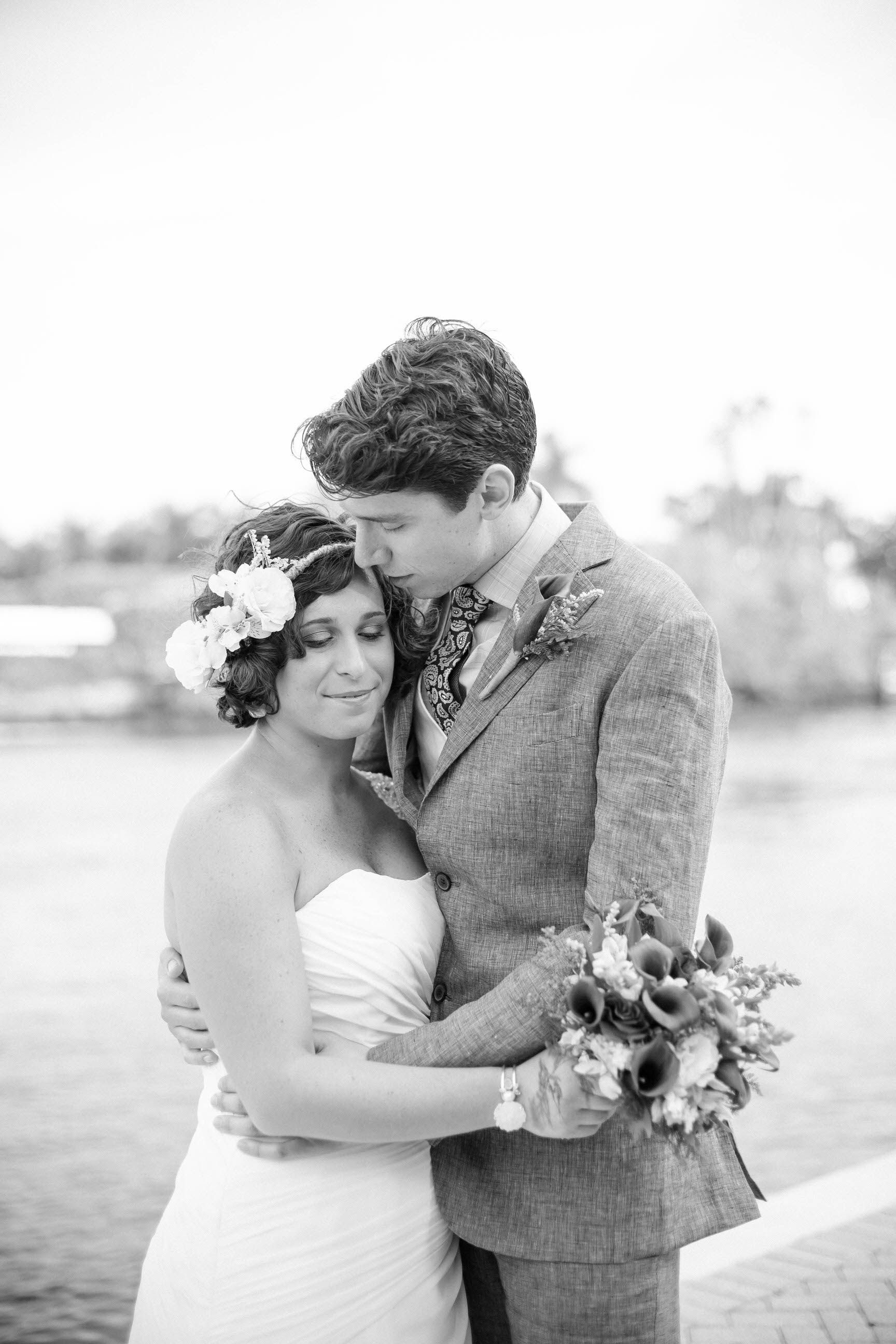 bride-groom-black-and-white-kissing-river.jpg