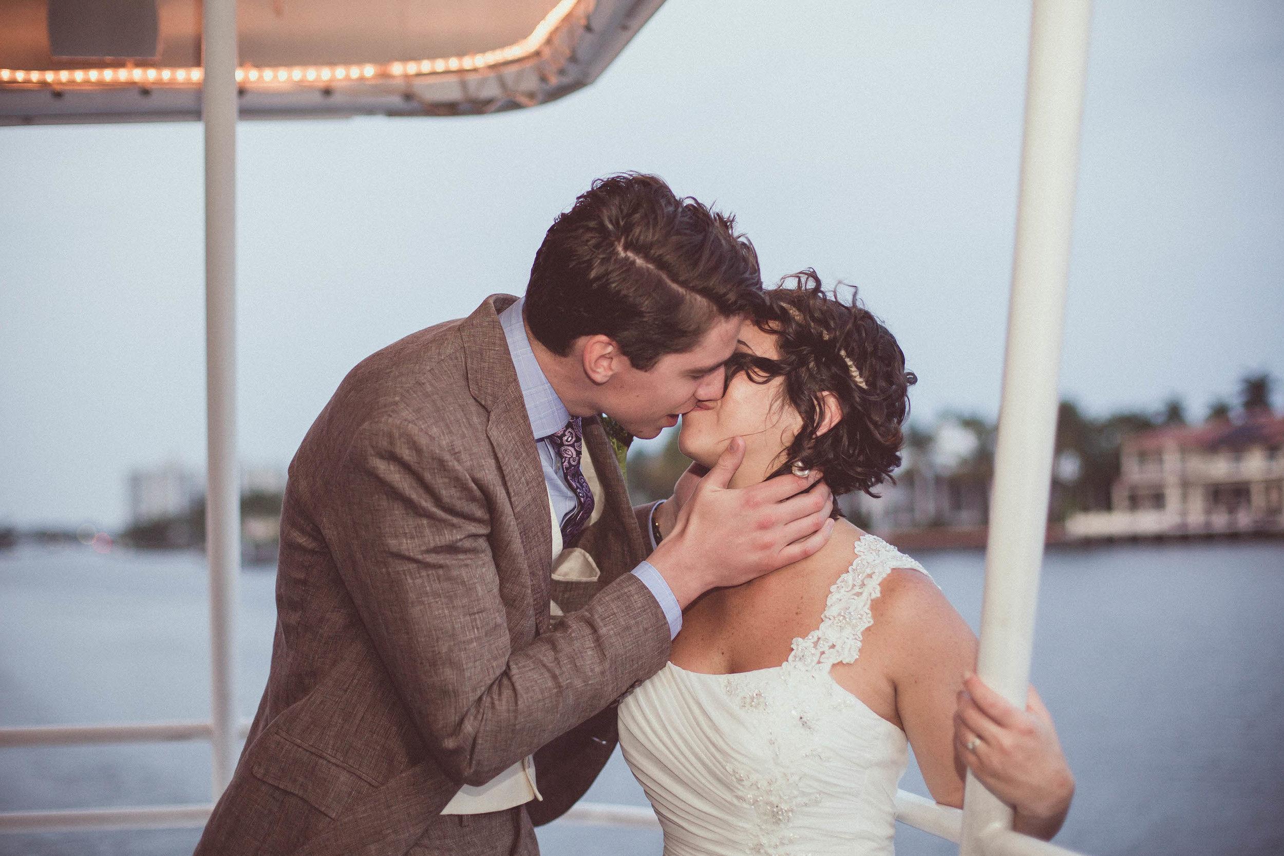 bride-groom-kissing-lady-delray-boat-destination-wedding.jpg
