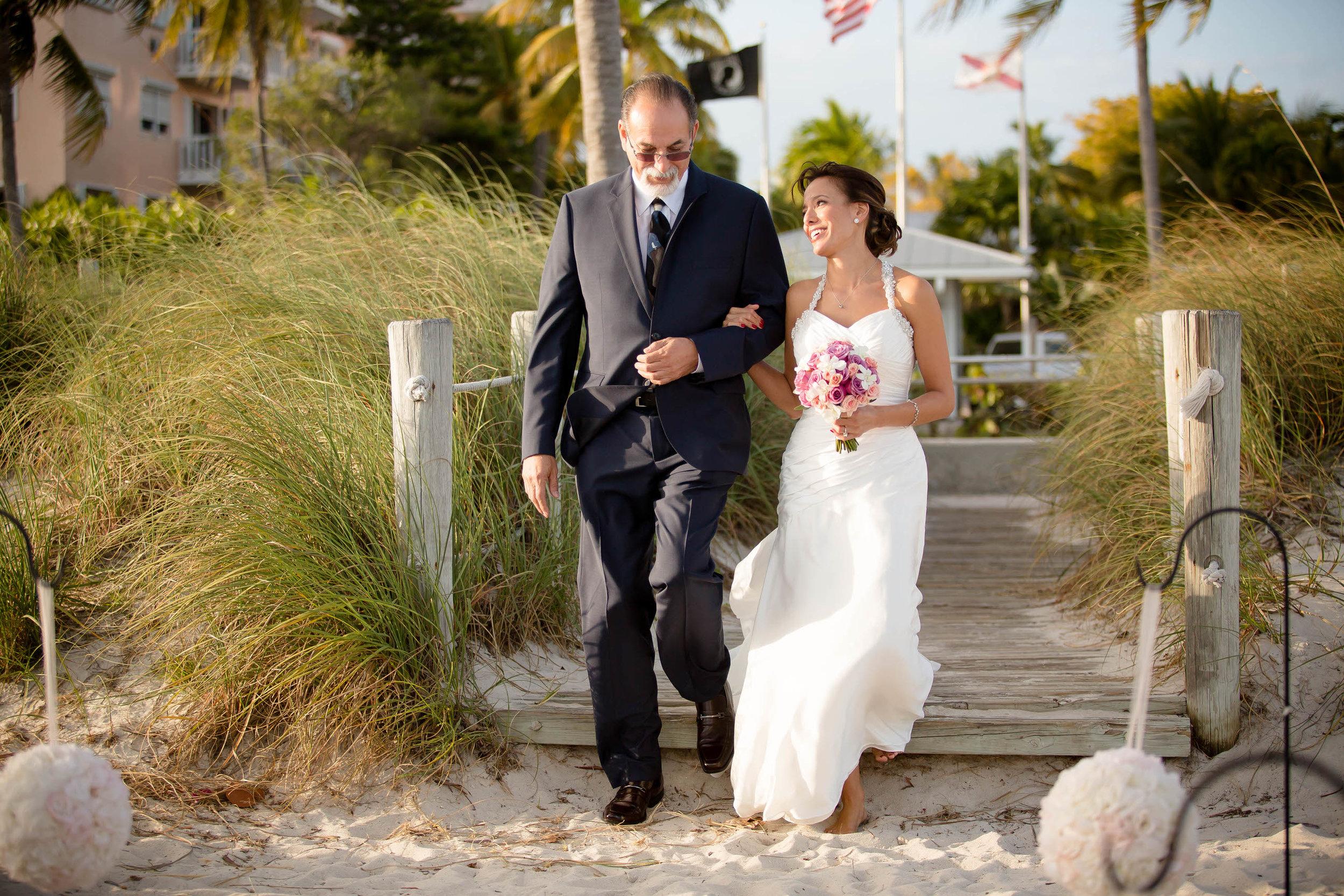 dad_walking_bride_isle_beach_wedding_tiny_house_photo.jpg