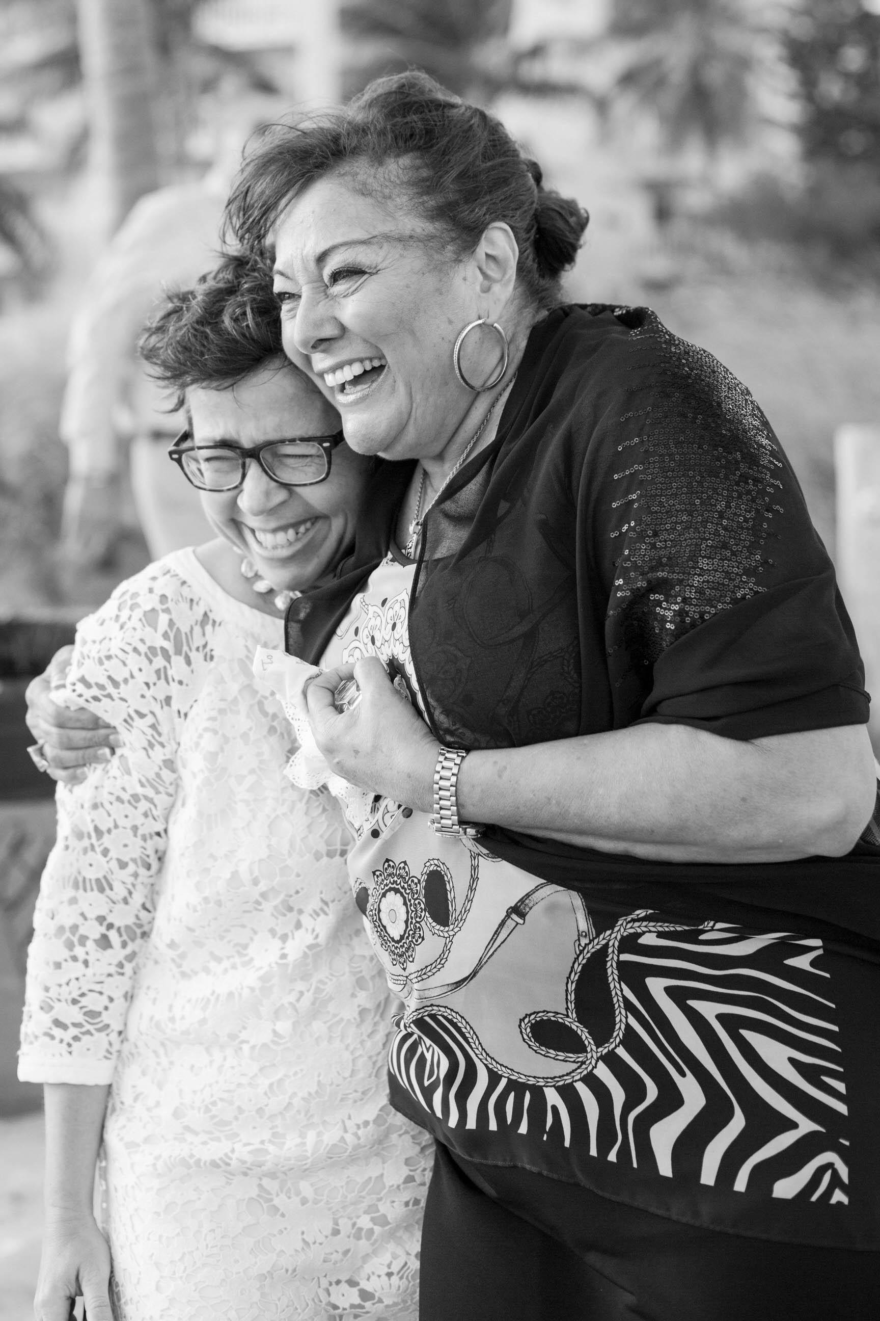 mom_laughing_wedding_emotional_tiny_house_photo.jpg