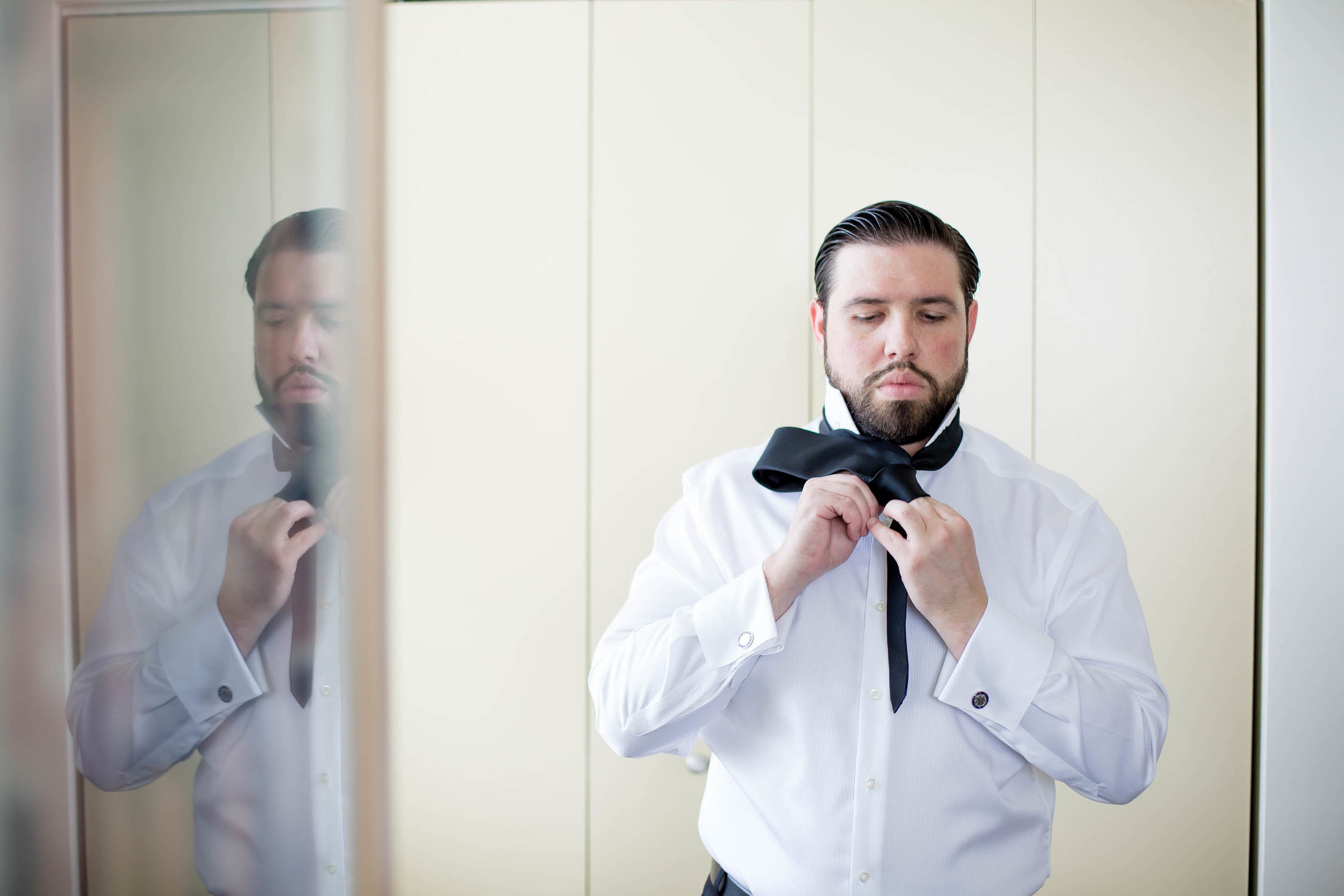tying_tie_groom_wedding_day_tiny_house_photo.jpg