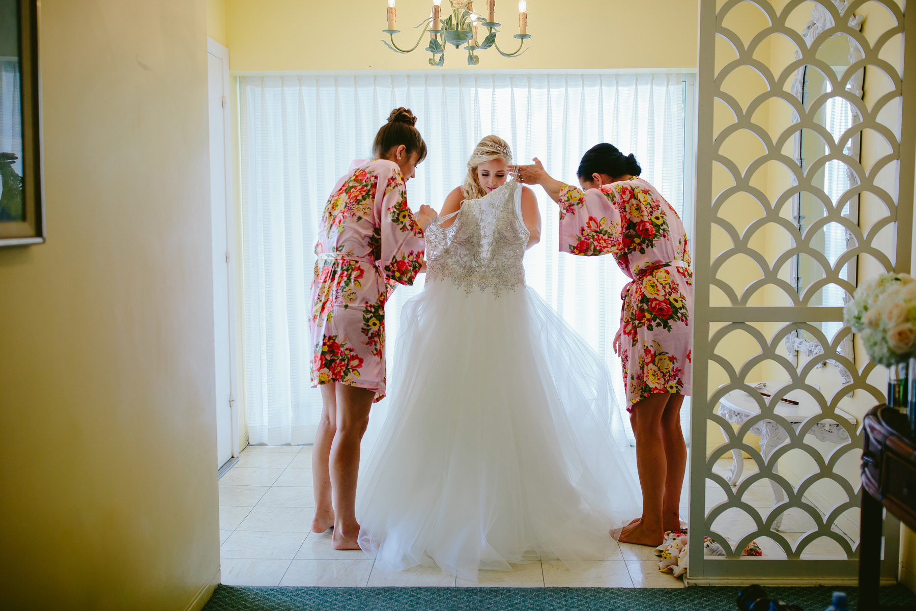 bride-getting-into-dress-tiny-house-photo-hillsboro-beach-club.jpg