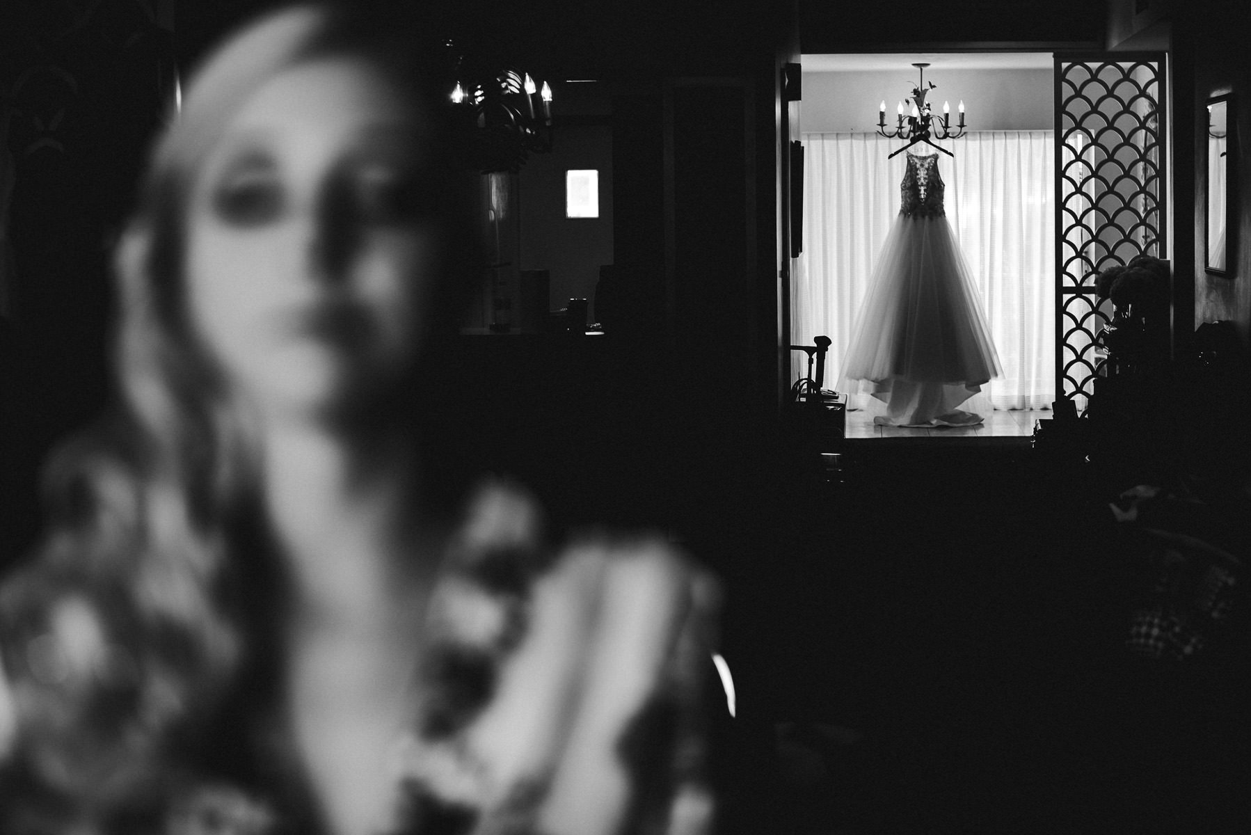 wedding-dress-bride-getting-ready-black-and-white-destination-photographer-tiny-house-photo.jpg