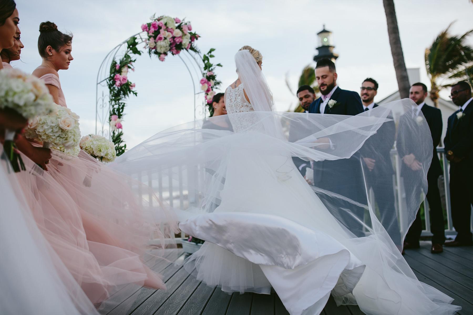windy-beach-wedding-veil-flying-tiny-house-photo-florida-photographer.jpg