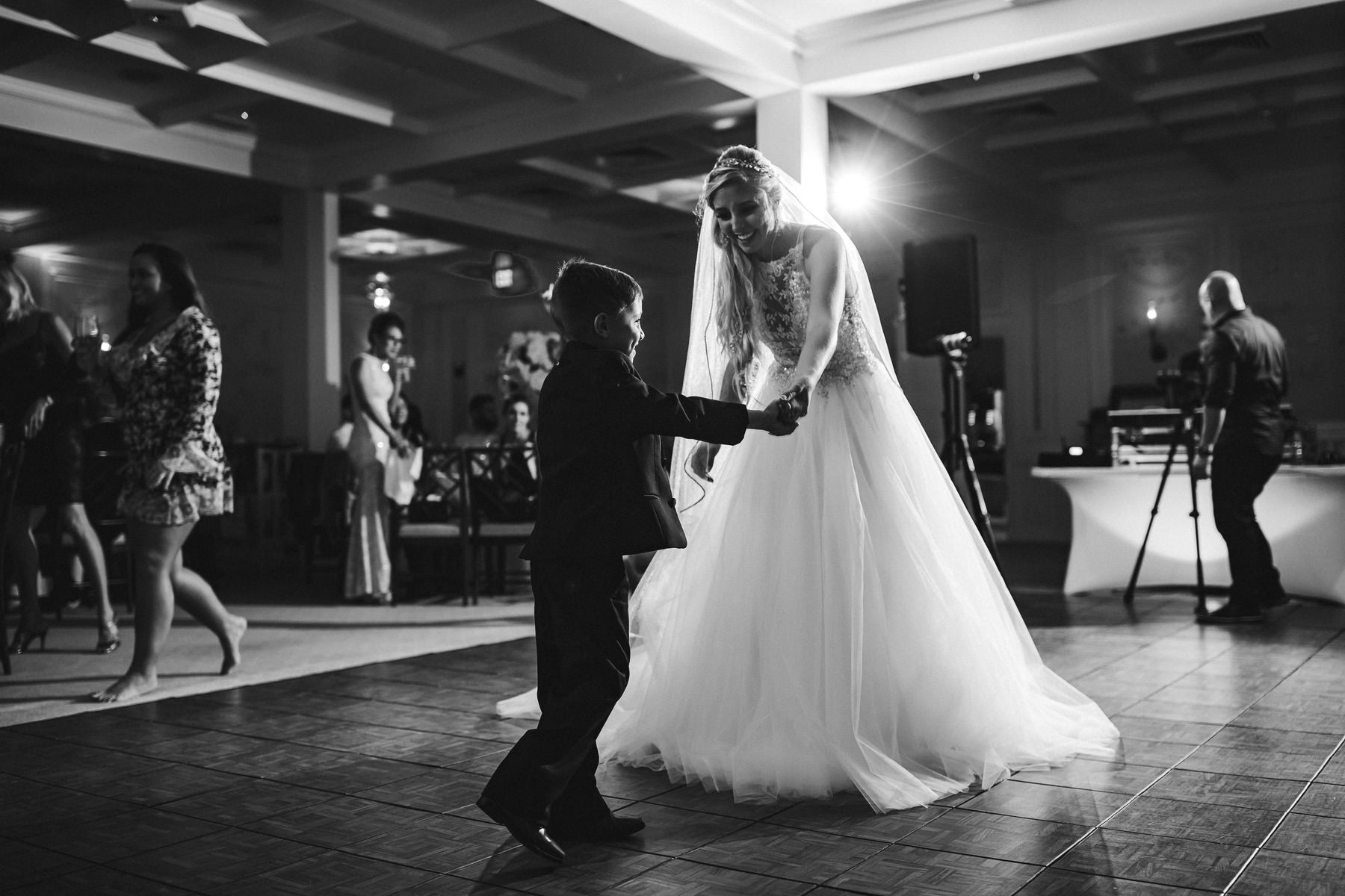 bride-son-dance-black-and-white-wedding-photography-tiny-house-photo.jpg