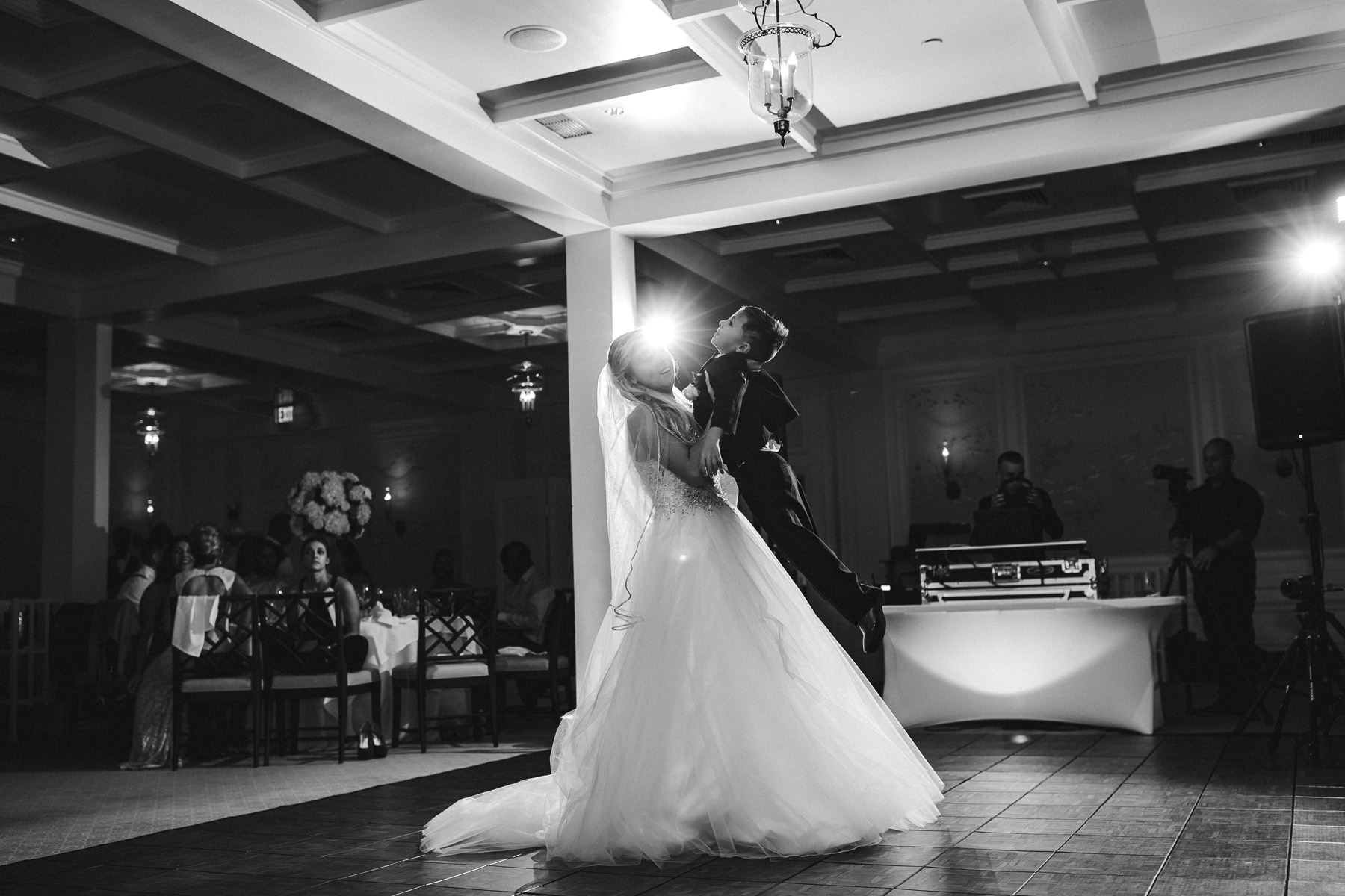 bride-son-dance-black-and-white-wedding-tiny-house-photo.jpg