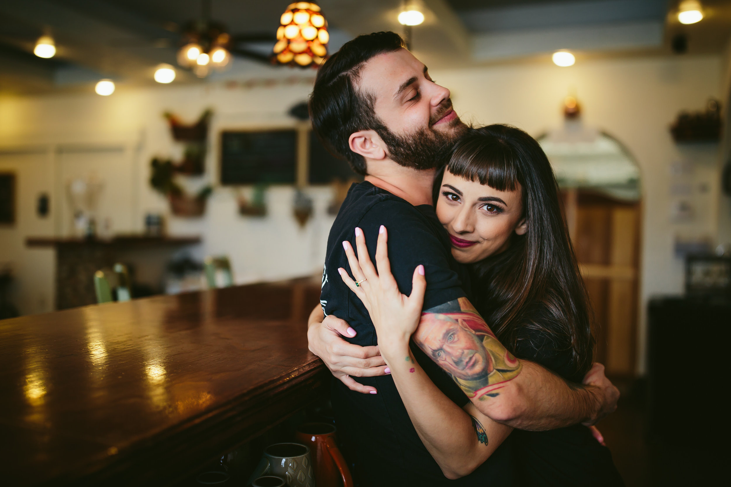 cute-couple-embrace-happy-engagement-wedding-photographer-south-florida-tiny-house-photo.jpg