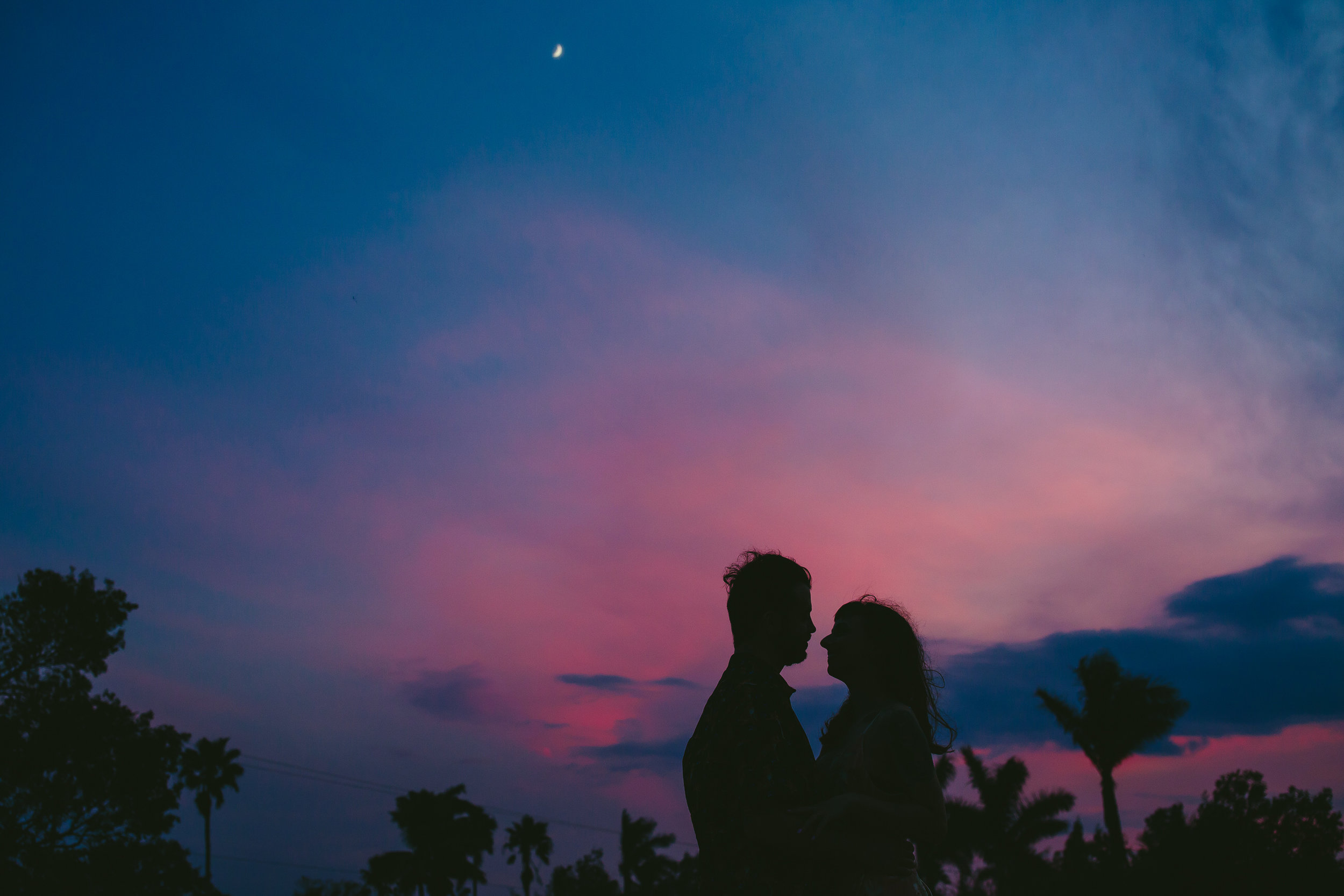 sunset-engagement-portraits-beautiful-sky-tiny-house-photo-sillouhette.jpg