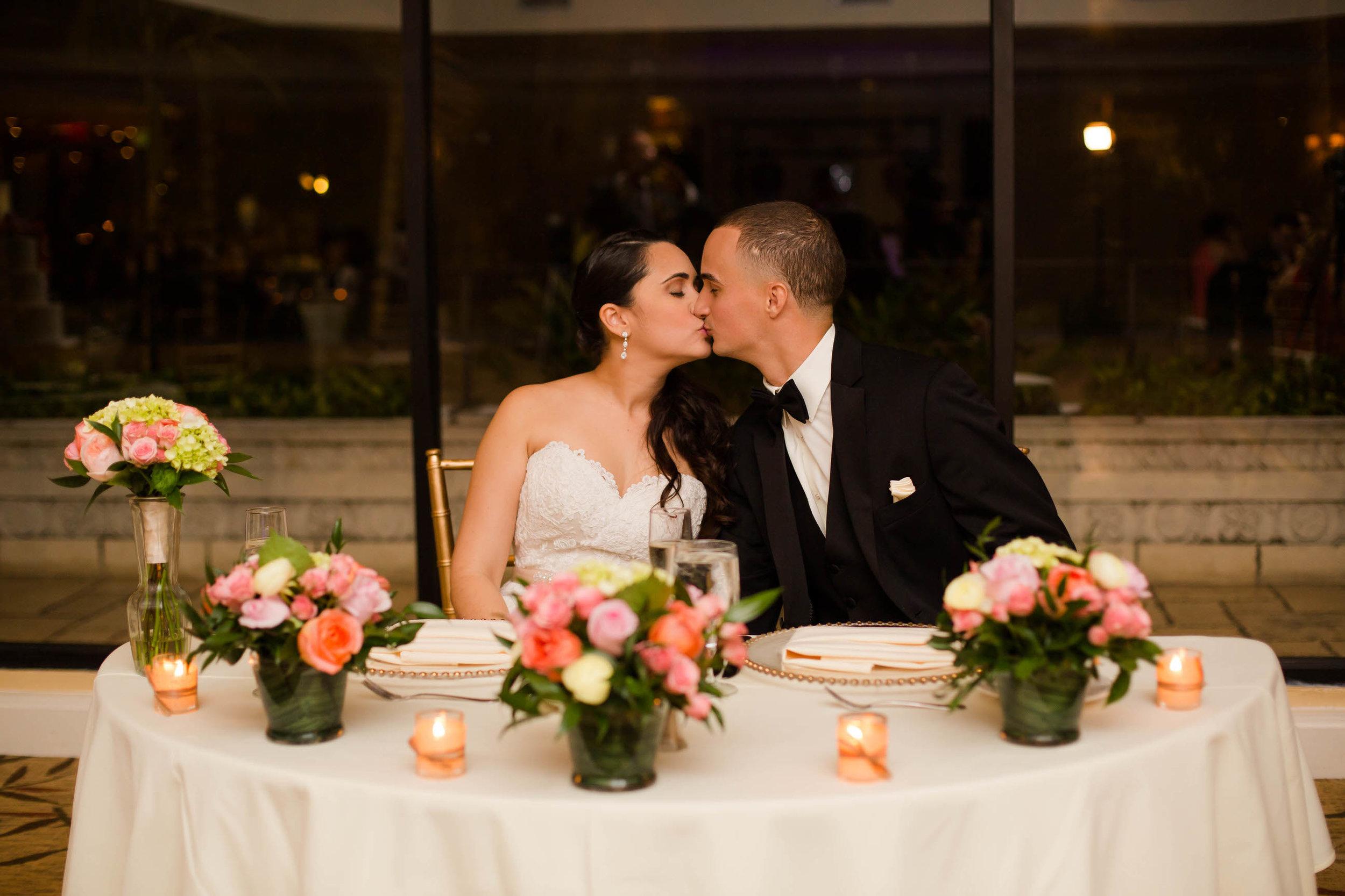 bride-groom-kiss-reception-tiny-house-photo.jpg
