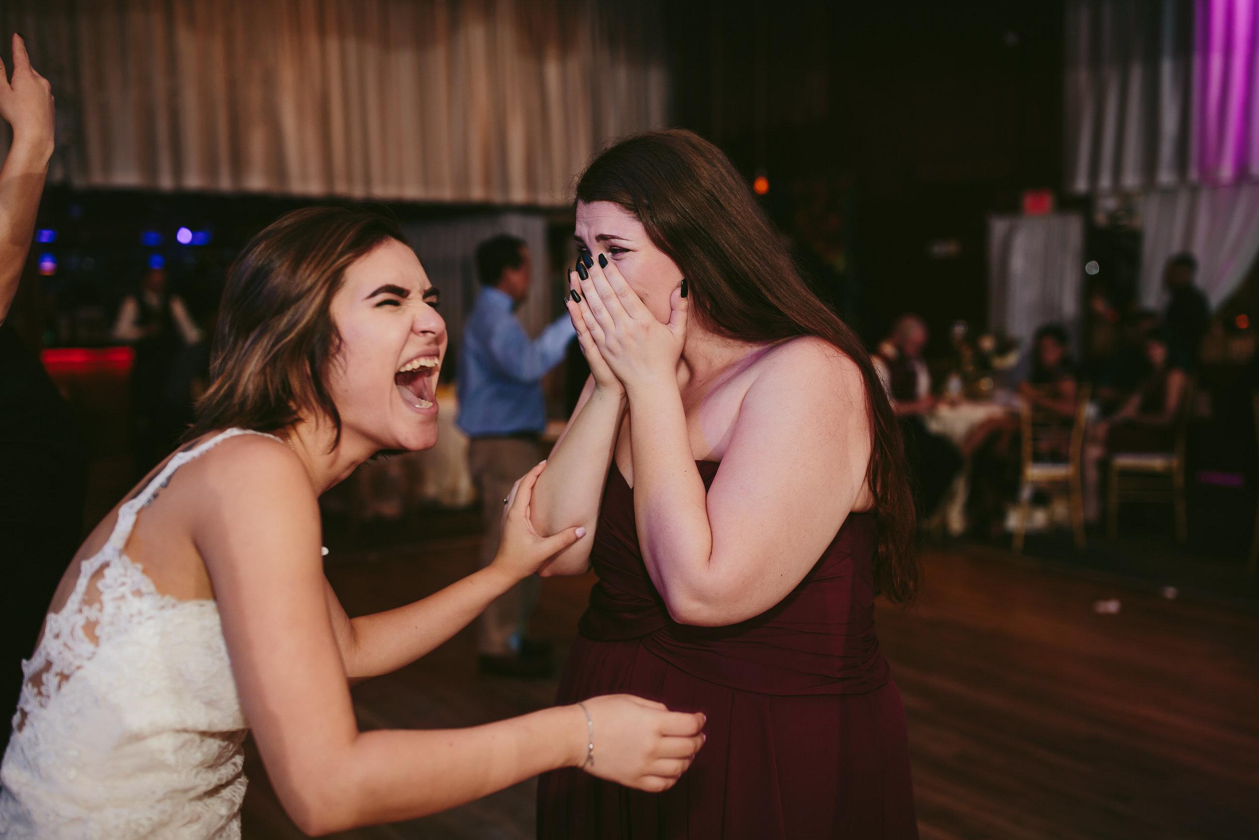 laughter_fun_wedding_reception_tiny_house_photo.jpg