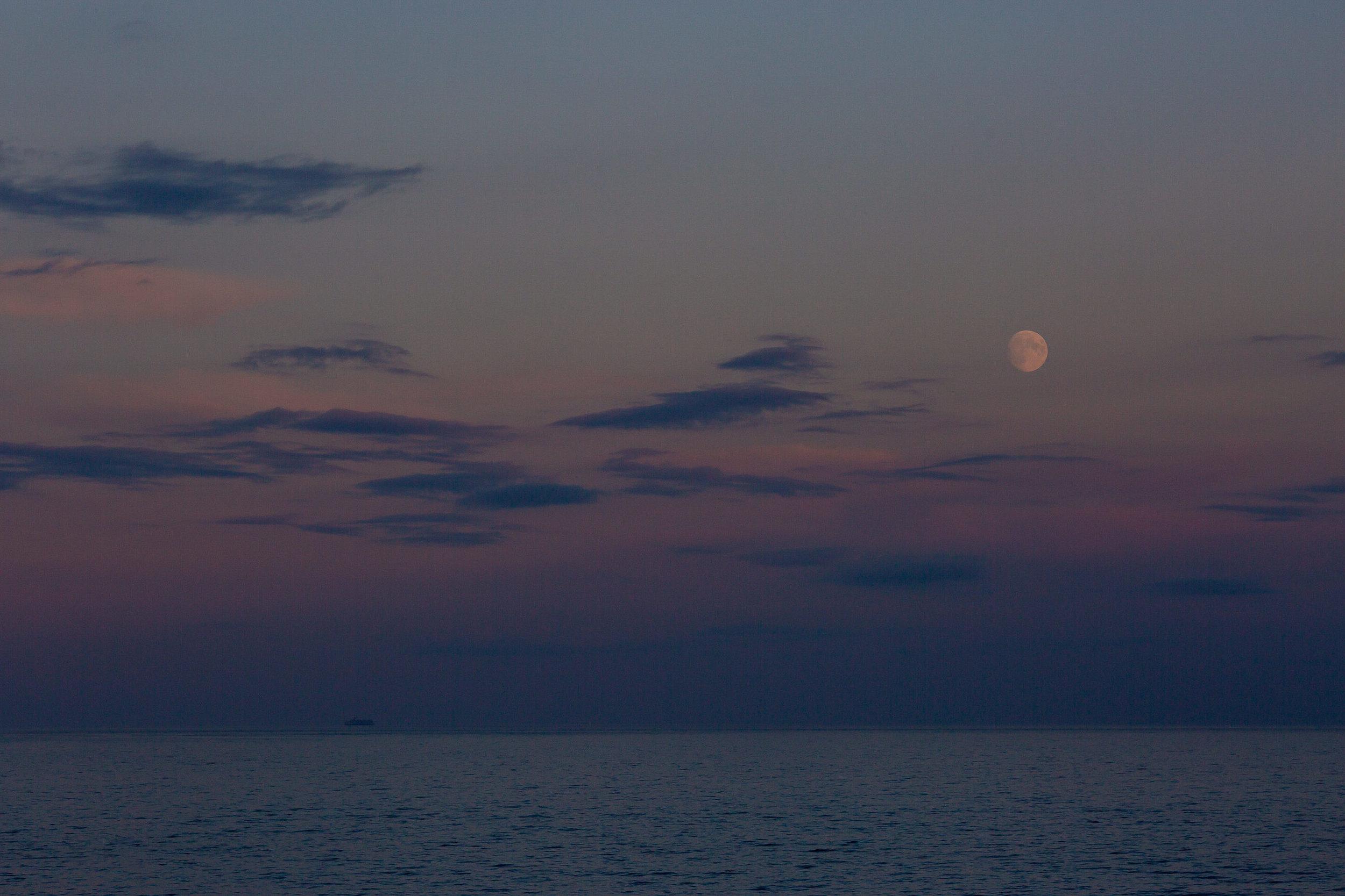 moon rising over alaska