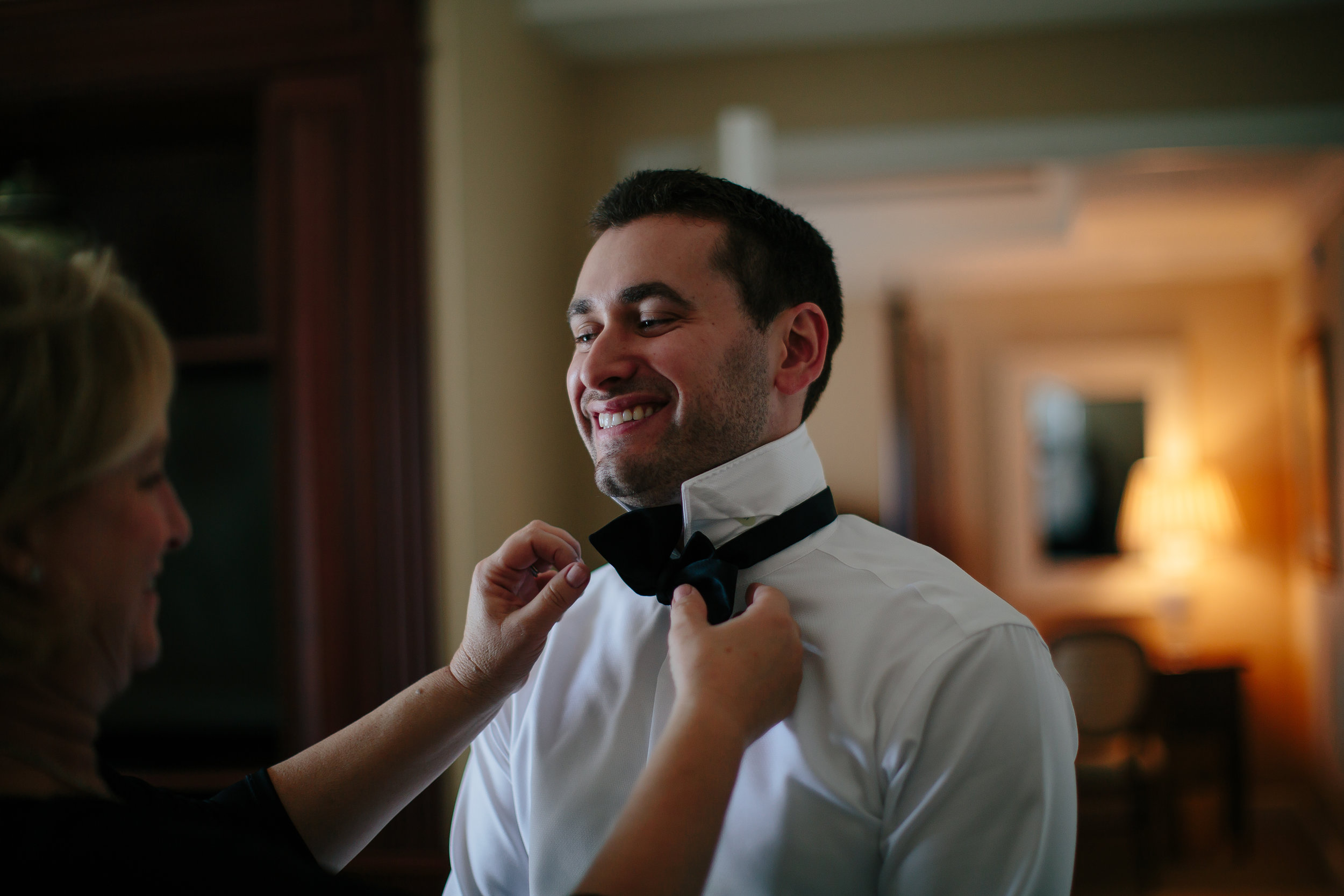 bowtie_groom_dressing_tiny_house_photo_weddings.jpg