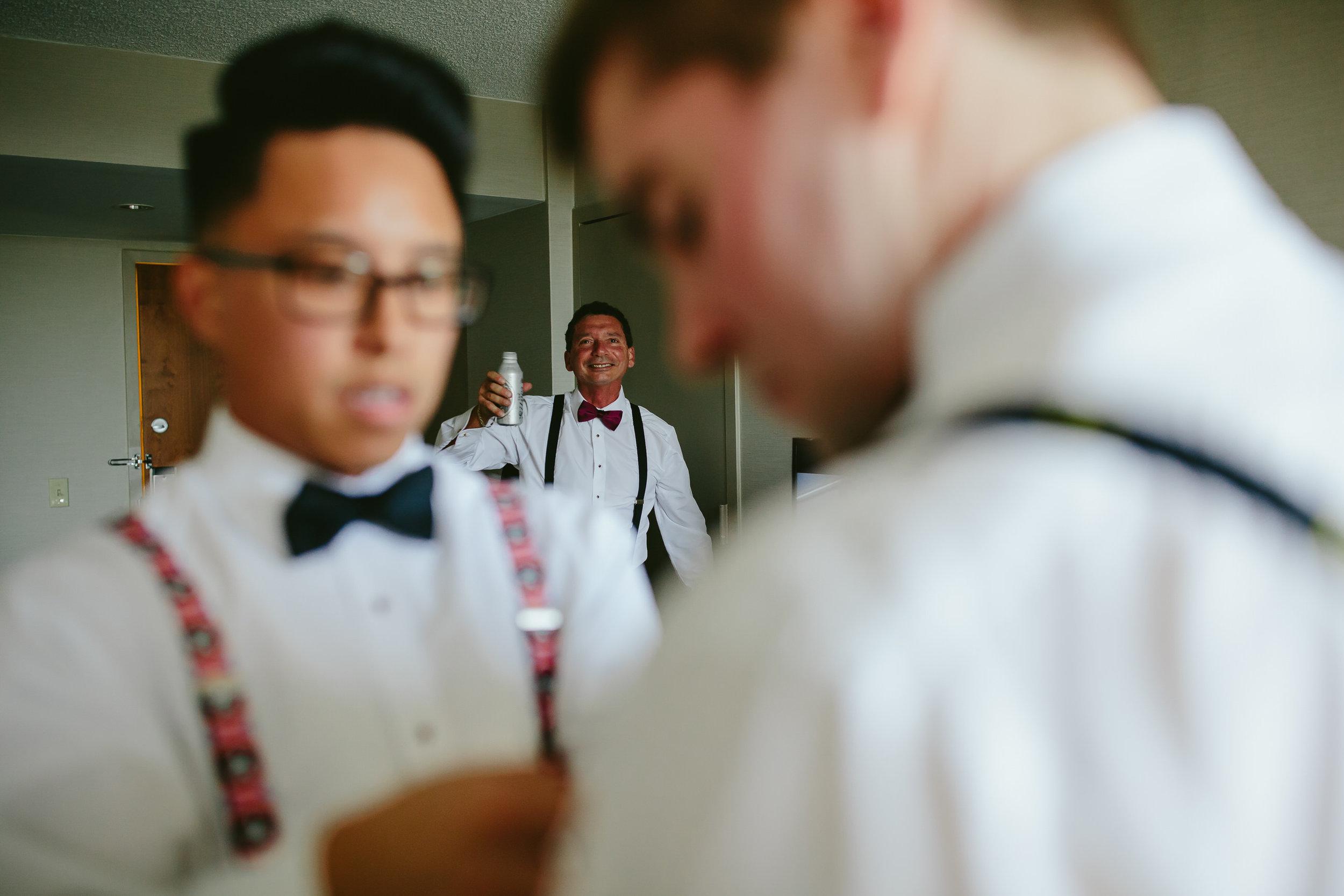 groom-getting-ready-florida-wedding-photographer-father-moment-tiny-house-photo.jpg
