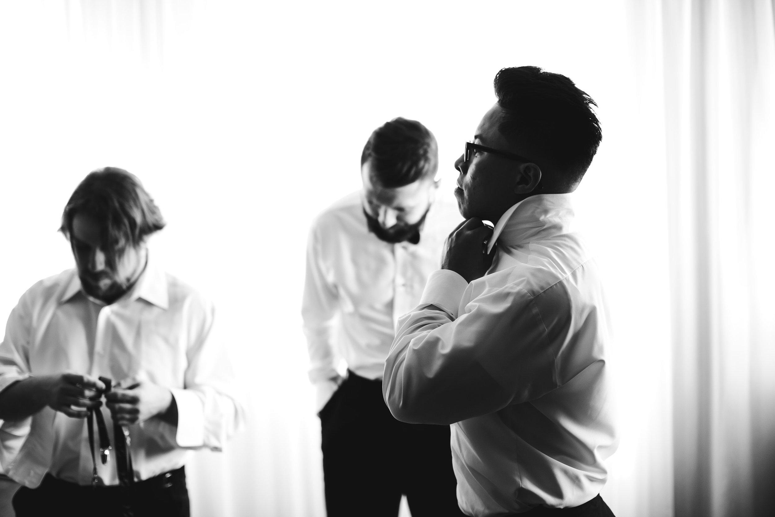 groom-getting-ready-international-wedding-photographer-tiny-house-photo.jpg