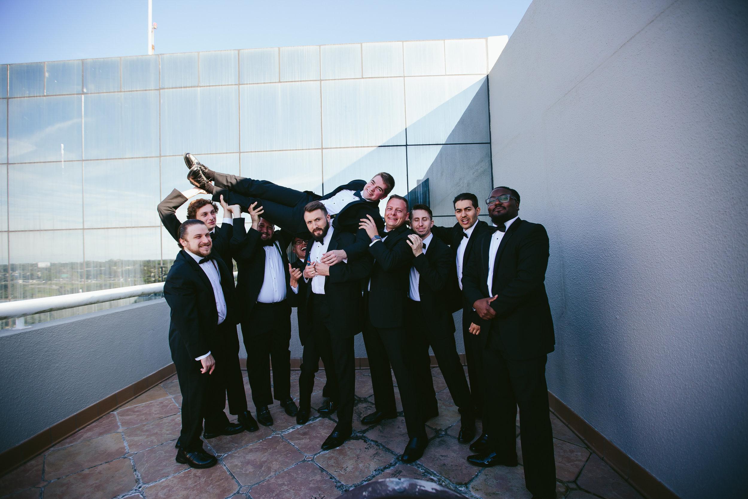 groomsman_being_silly_fun_viral_wedding_photo_tiny_house_photo.jpg