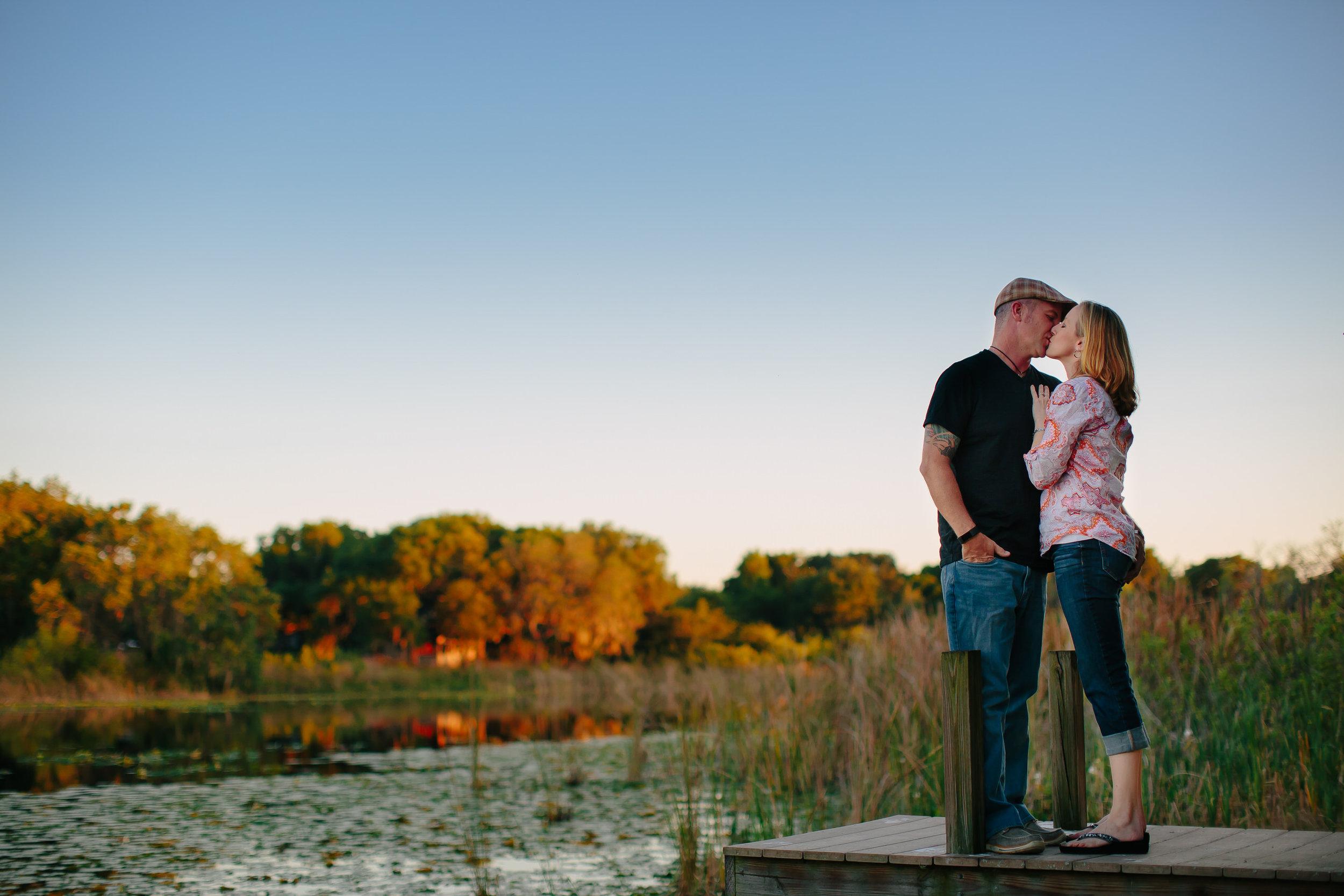 couple_kissing_tiny_house_photo_lake_apopka_florida_destination_weddings.jpg