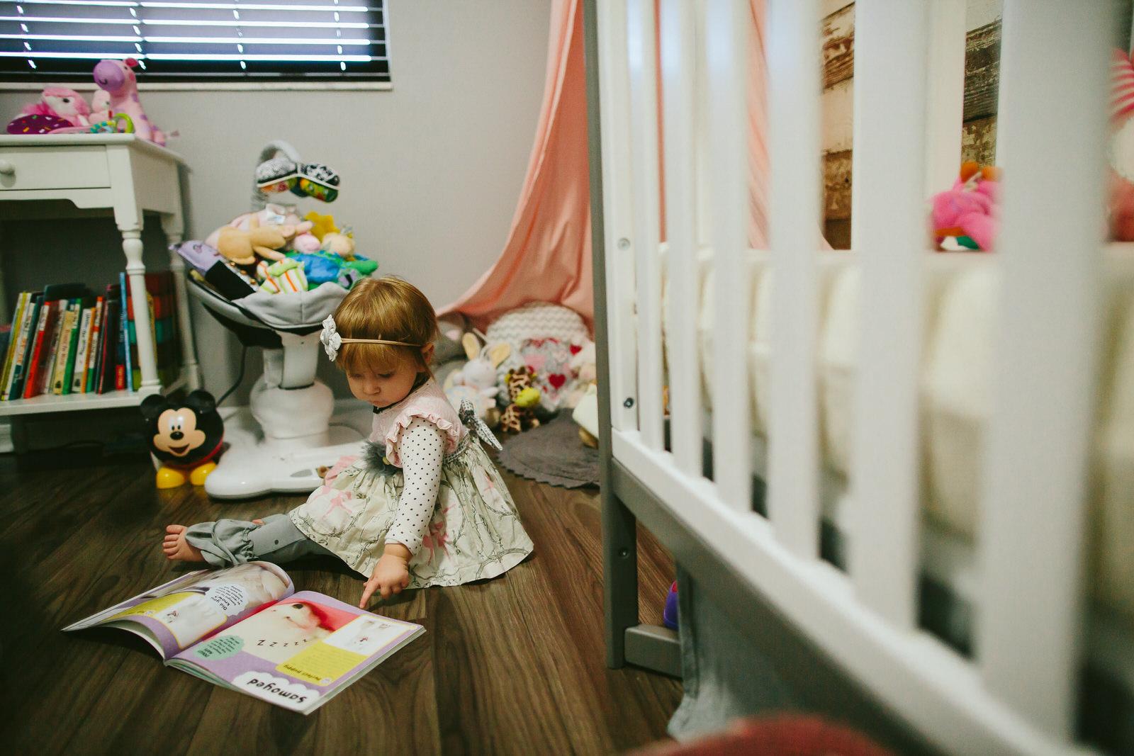 toddler reading book tiny house photo documentary family photography