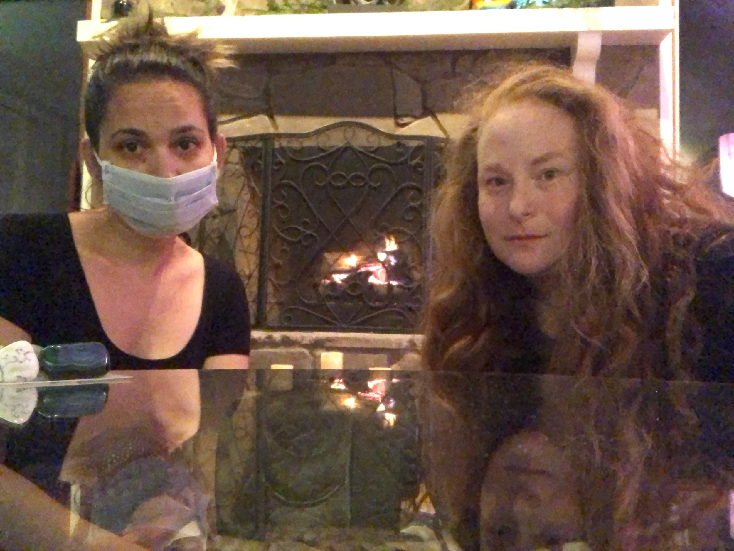 two florida girls enjoying the fireplace
