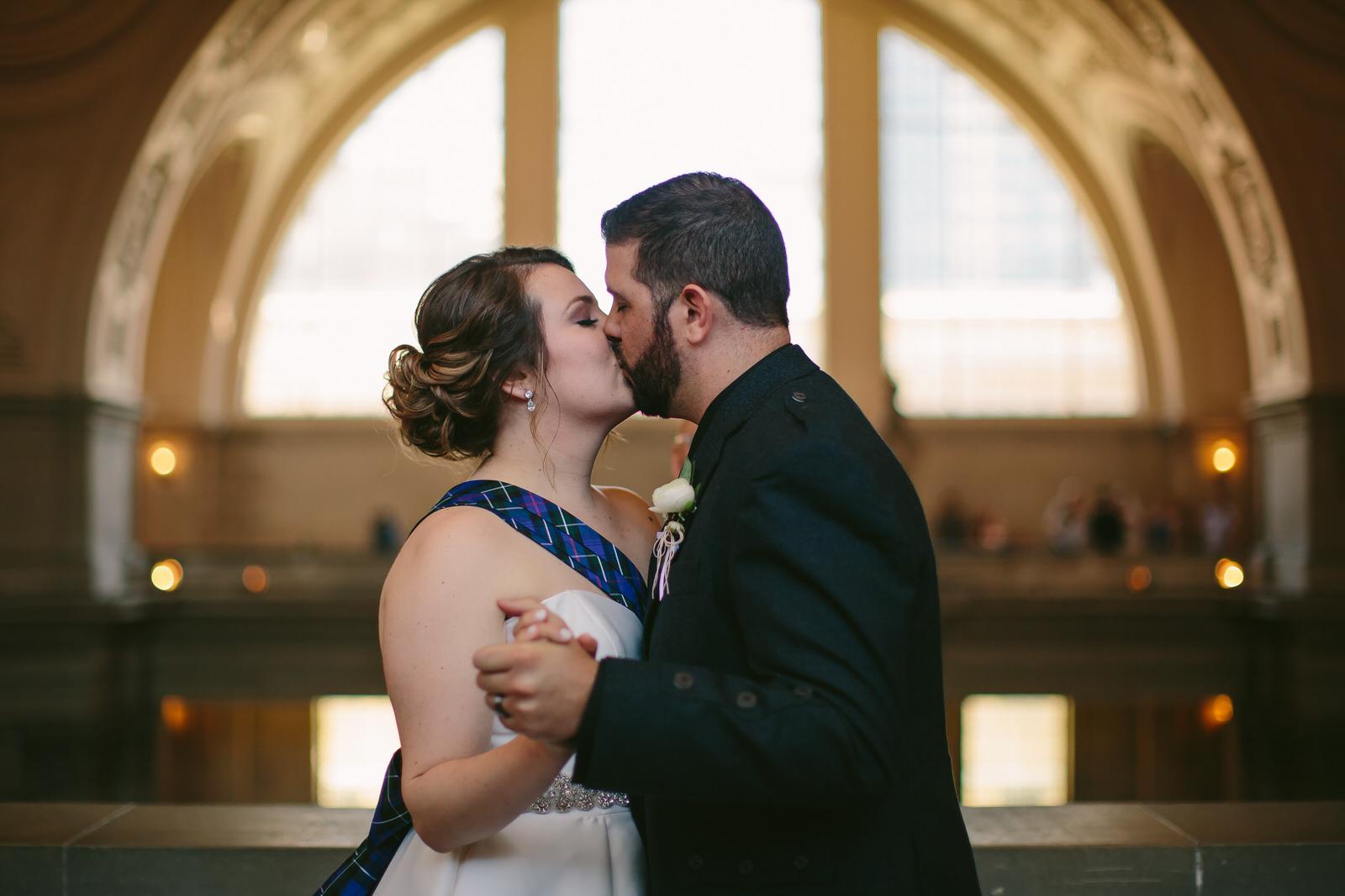 first_kiss_husband_wife_intimate_wedding_san_francisco_city_hall.jpg