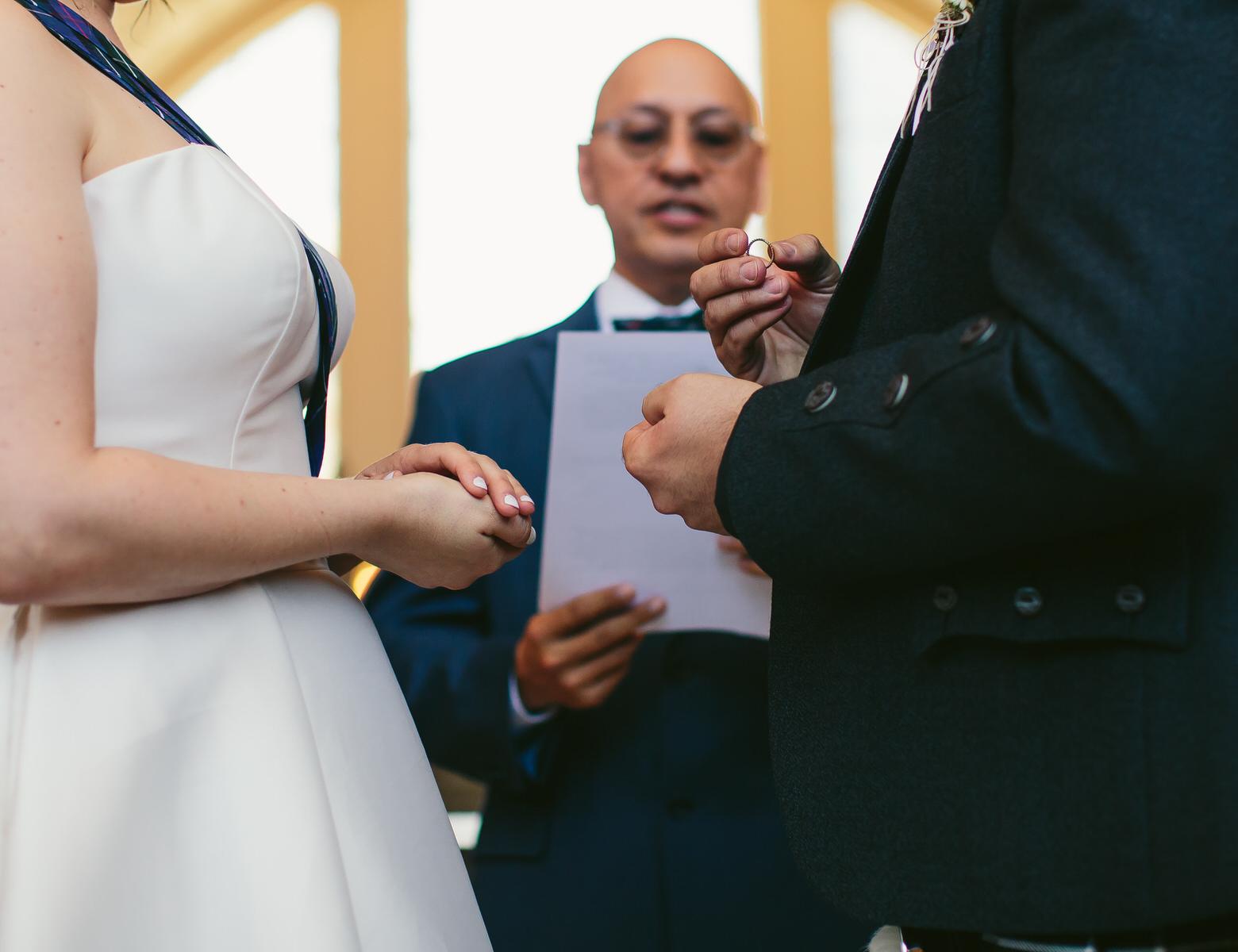 the_groom_holding_the_ring_tiny_house_photo_san_francisco_city_hall_wedding.jpg