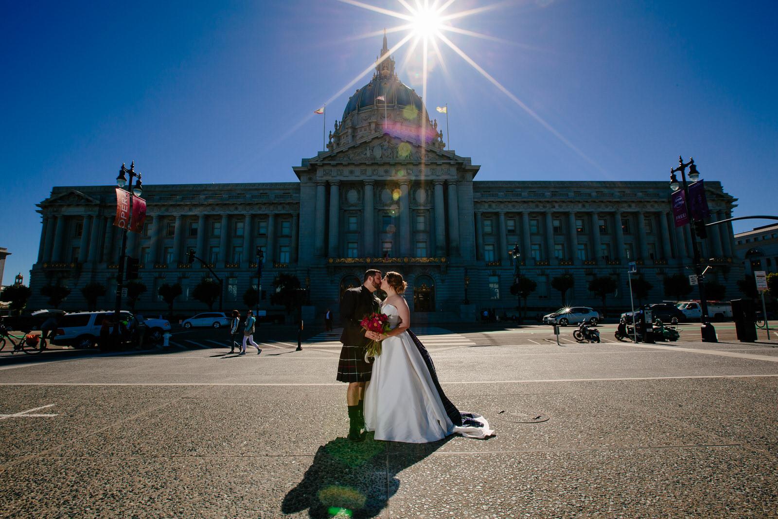couple_kissing_san_francisco_city_hall_wedding.jpg