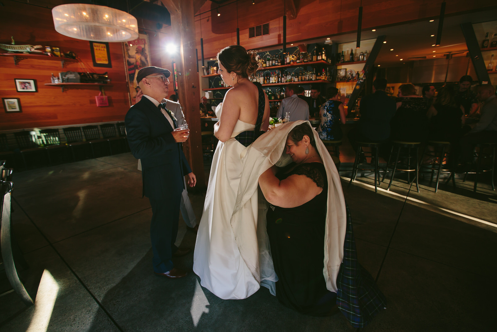 moments_wedding_reception_hilarious_bustle_bride_tiny_house_photo.jpg