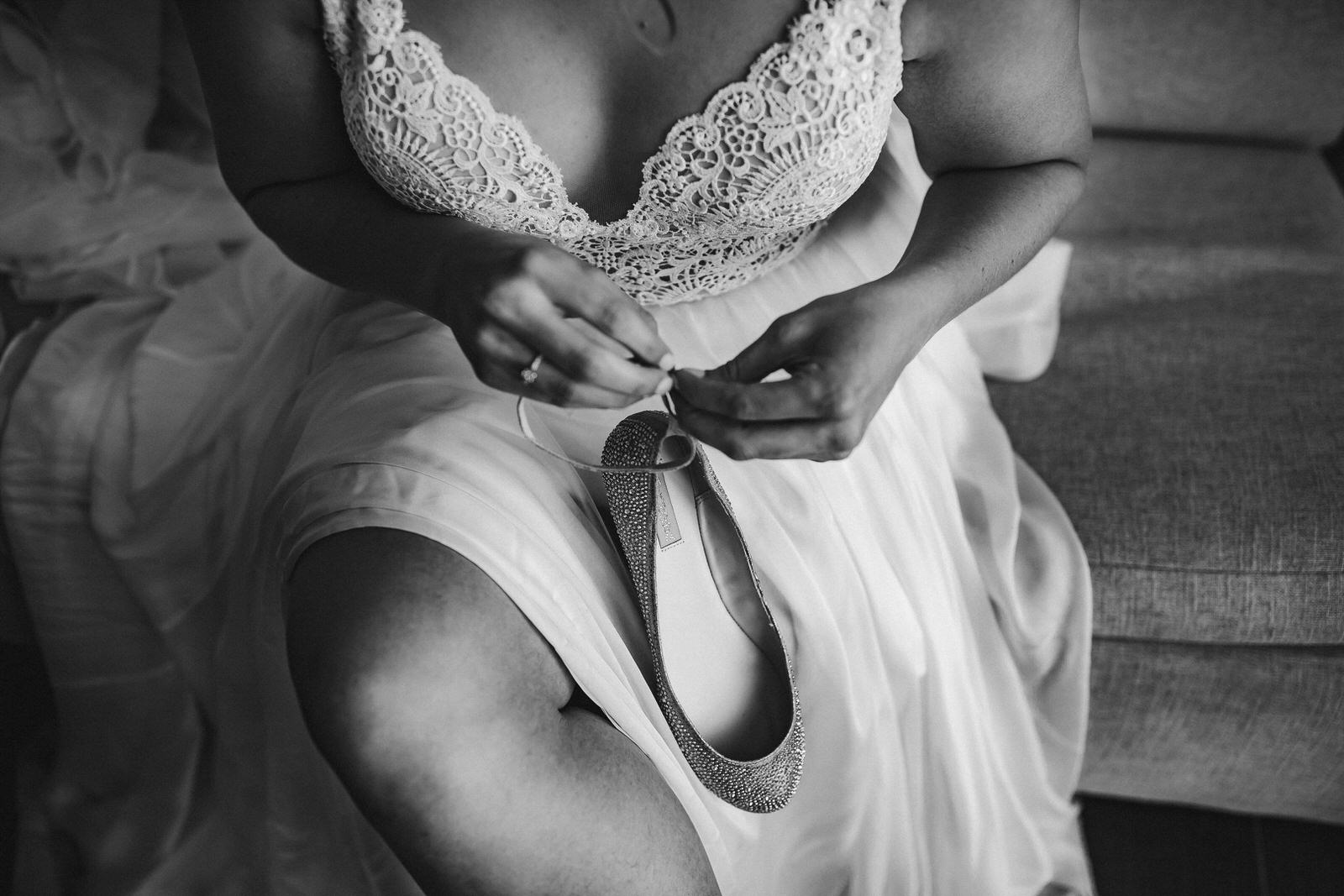 bride_getting_ready_shoes_black_and_white_wedding_photography.jpg