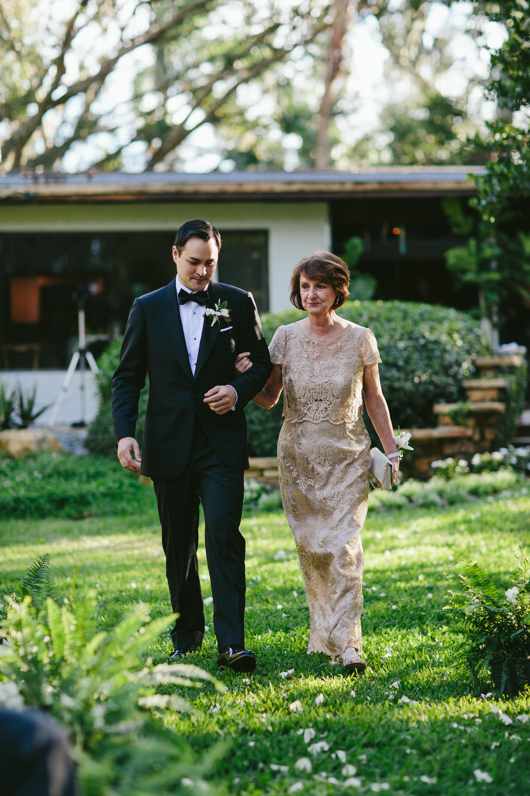 groom_processional_mog_wedding_backyard_twilight_inspired_tiny_house_photo.jpg