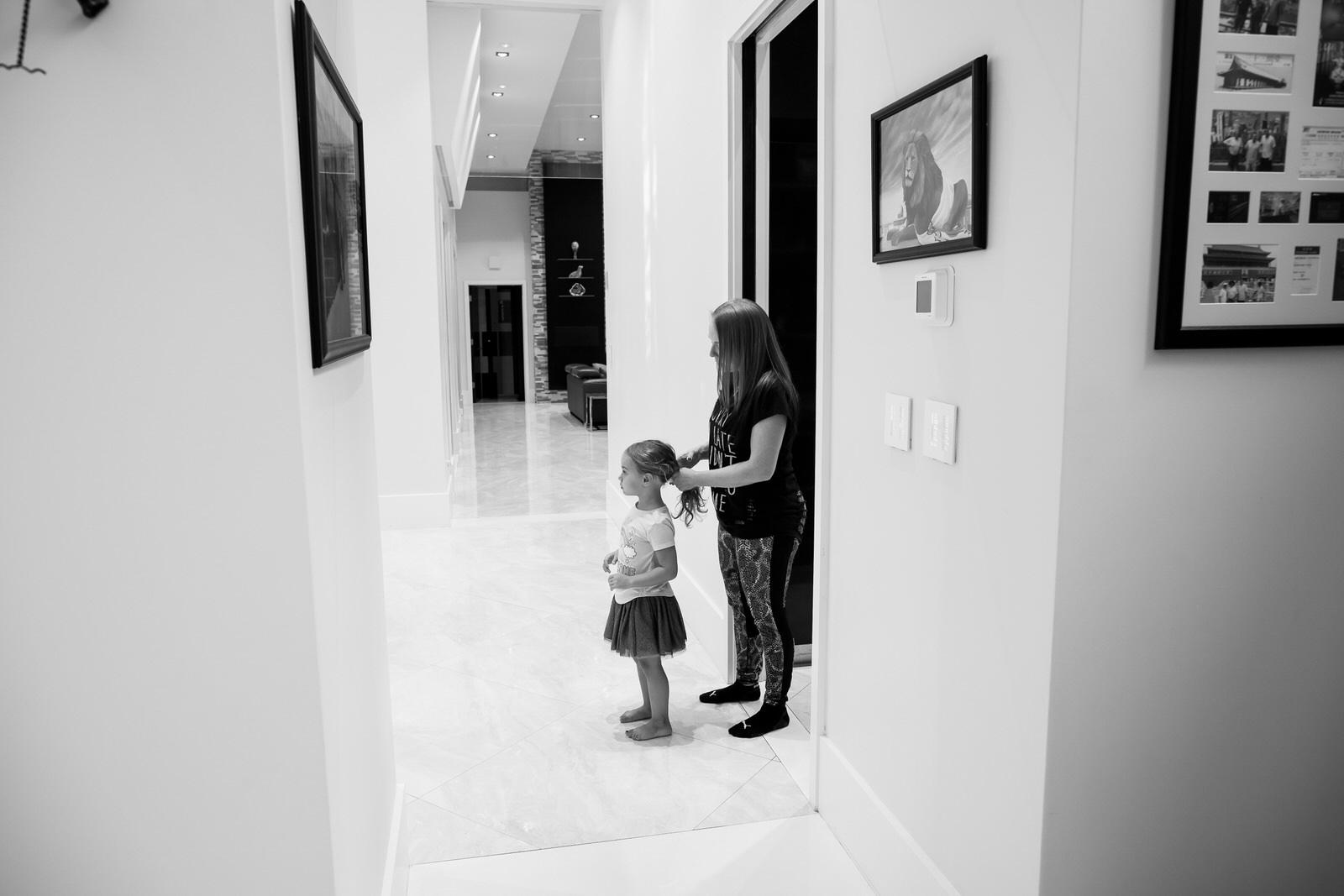 mom_braiding_daughters_hair_documentary_family_photography.jpg