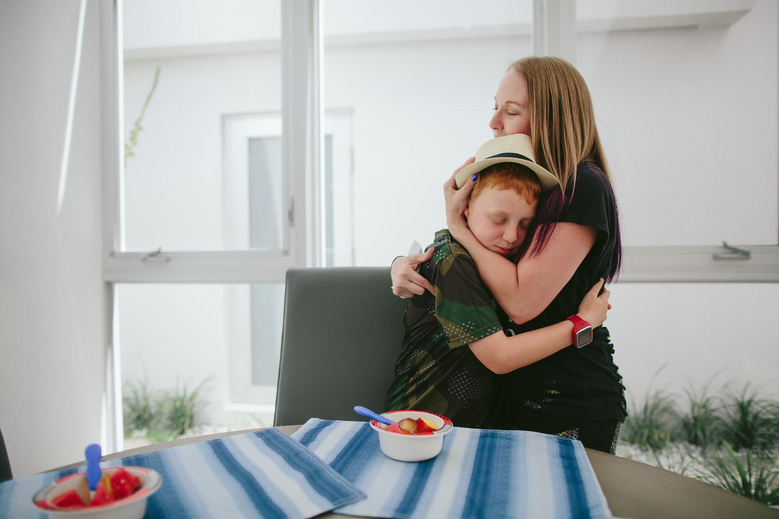 mom_hugging_son_family_DITL.jpg