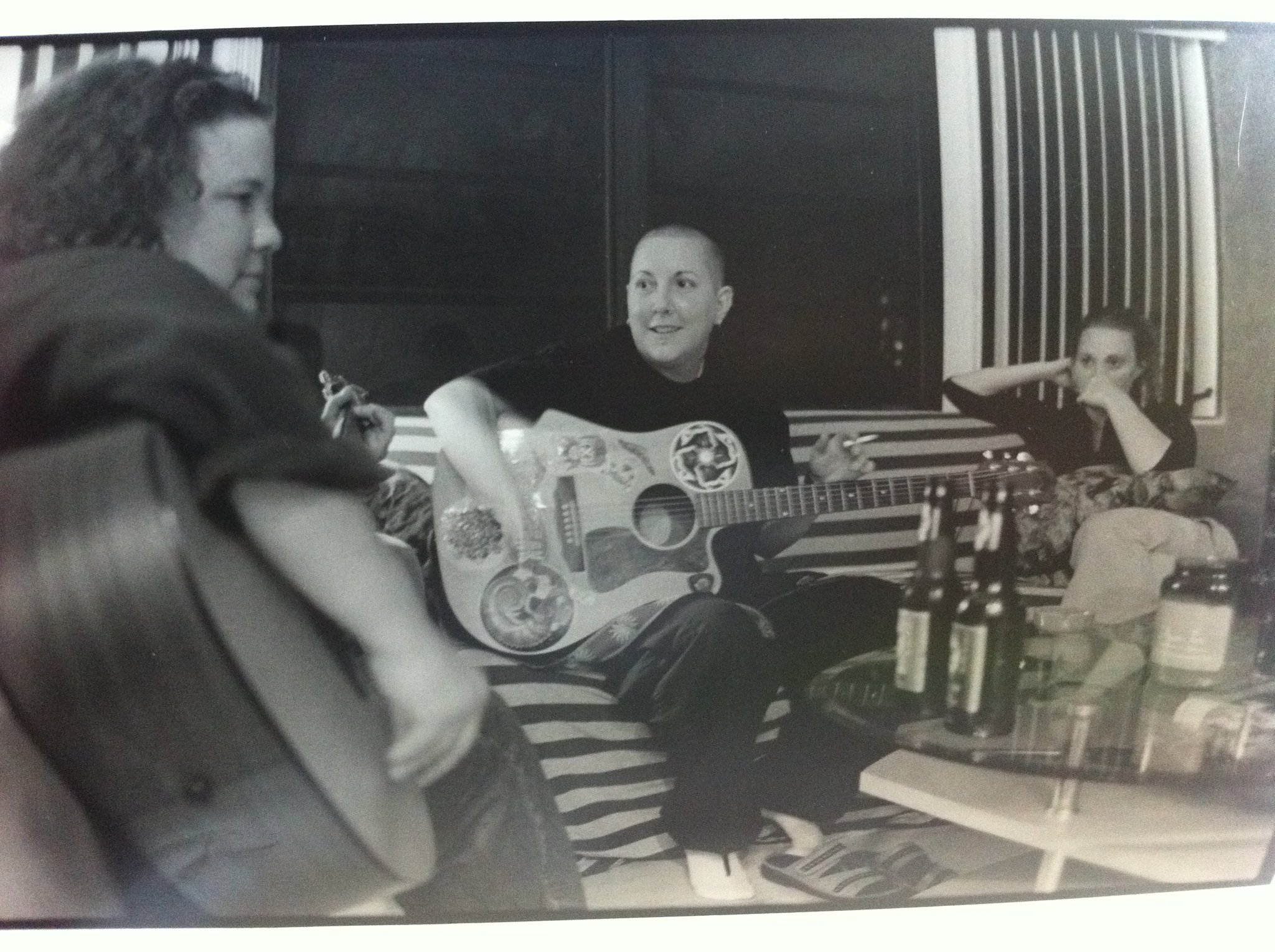 beverly mcclellan writing music and playing guitar in florida 2003. black and white image.