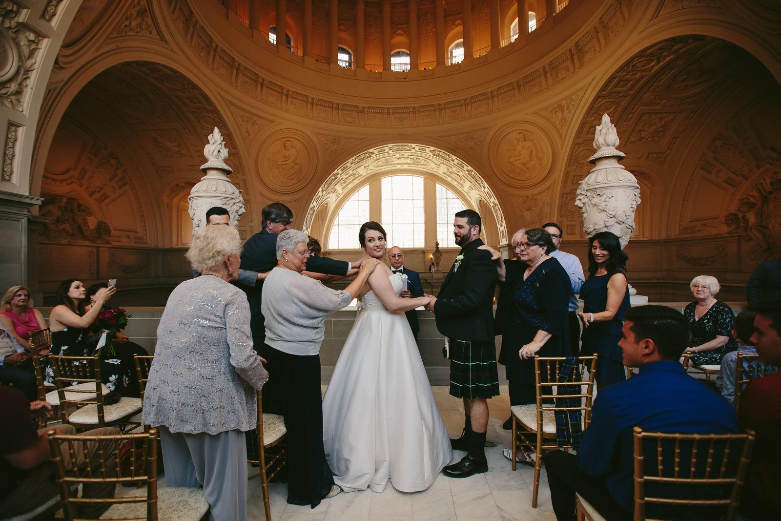 touching_embrace_wedding_san_francisco_city_hall_intimate_wedding.jpg