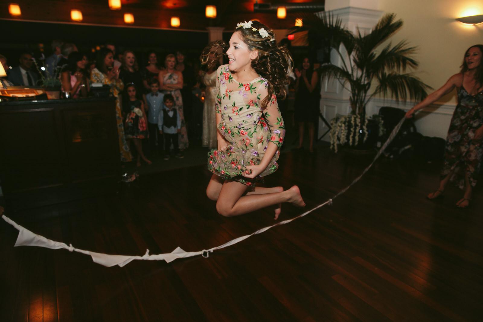 playing-jump-rope-wedding-reception-jensen-beach-wedding-photographer-tiny-house-photo