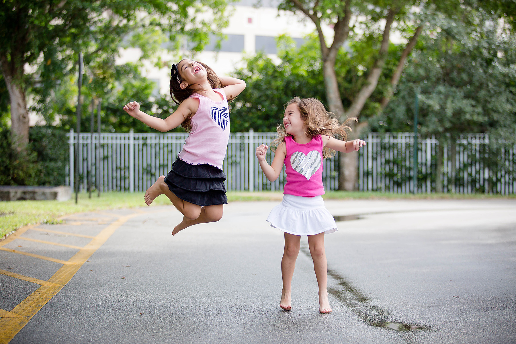 broward-family-photographer-siblings-jump-fun-love-silly-sisters-photography.jpg