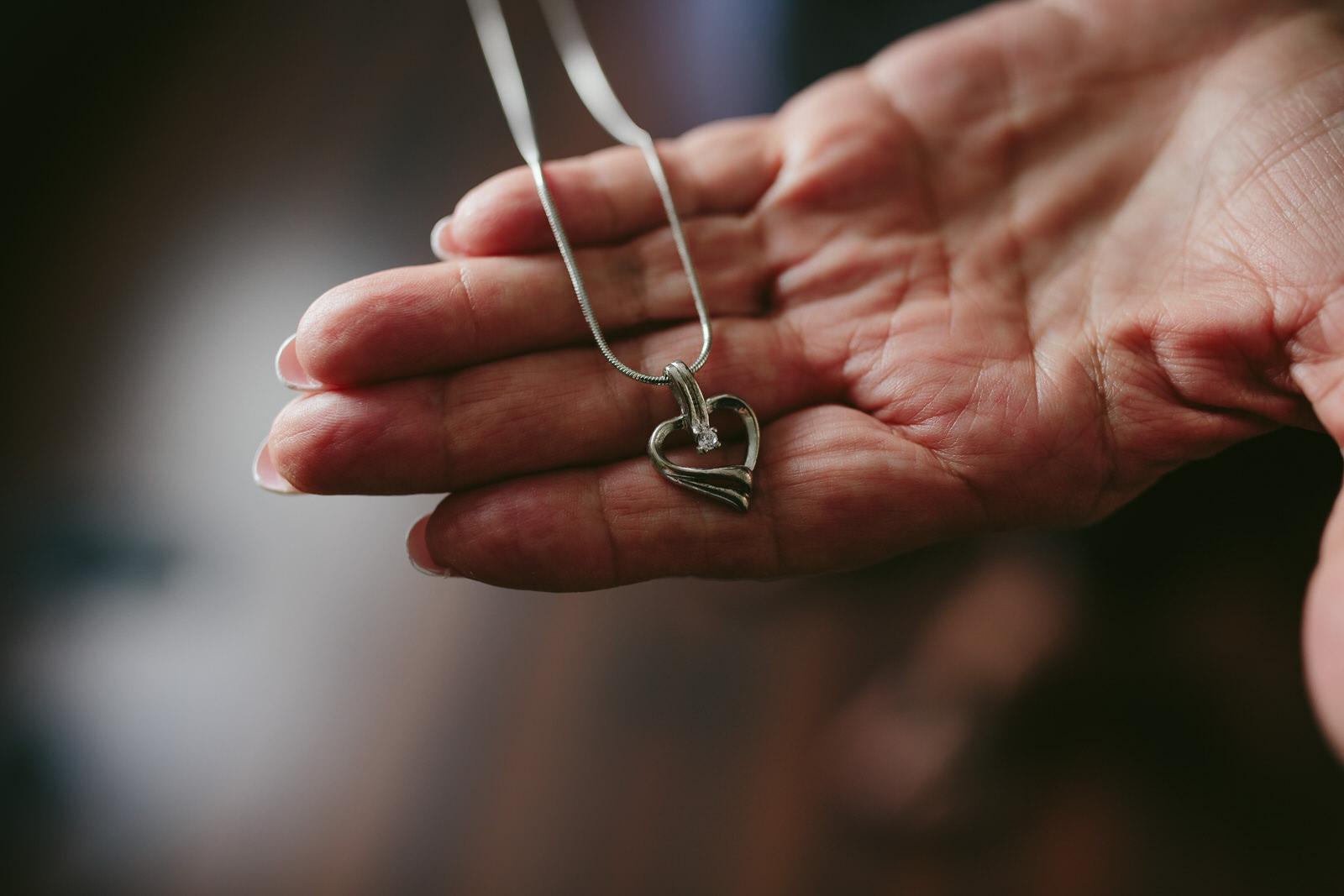 mom-holding-necklace-tiny-house-photo-intimate-wedding-portraits.jpg
